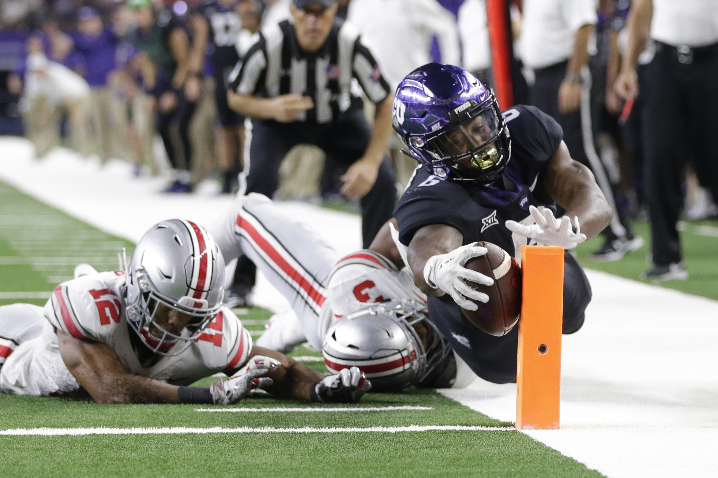 Sep 15, 2018; Arlington, TX, USA; TCU Horned Frogs running back Darius Anderson (6) scores a touchdown against Ohio State Buckeyes cornerback Damon Arnette Jr. (3) in the third quarter at AT&T Stadium. Mandatory Credit: Tim Heitman-USA TODAY Sports