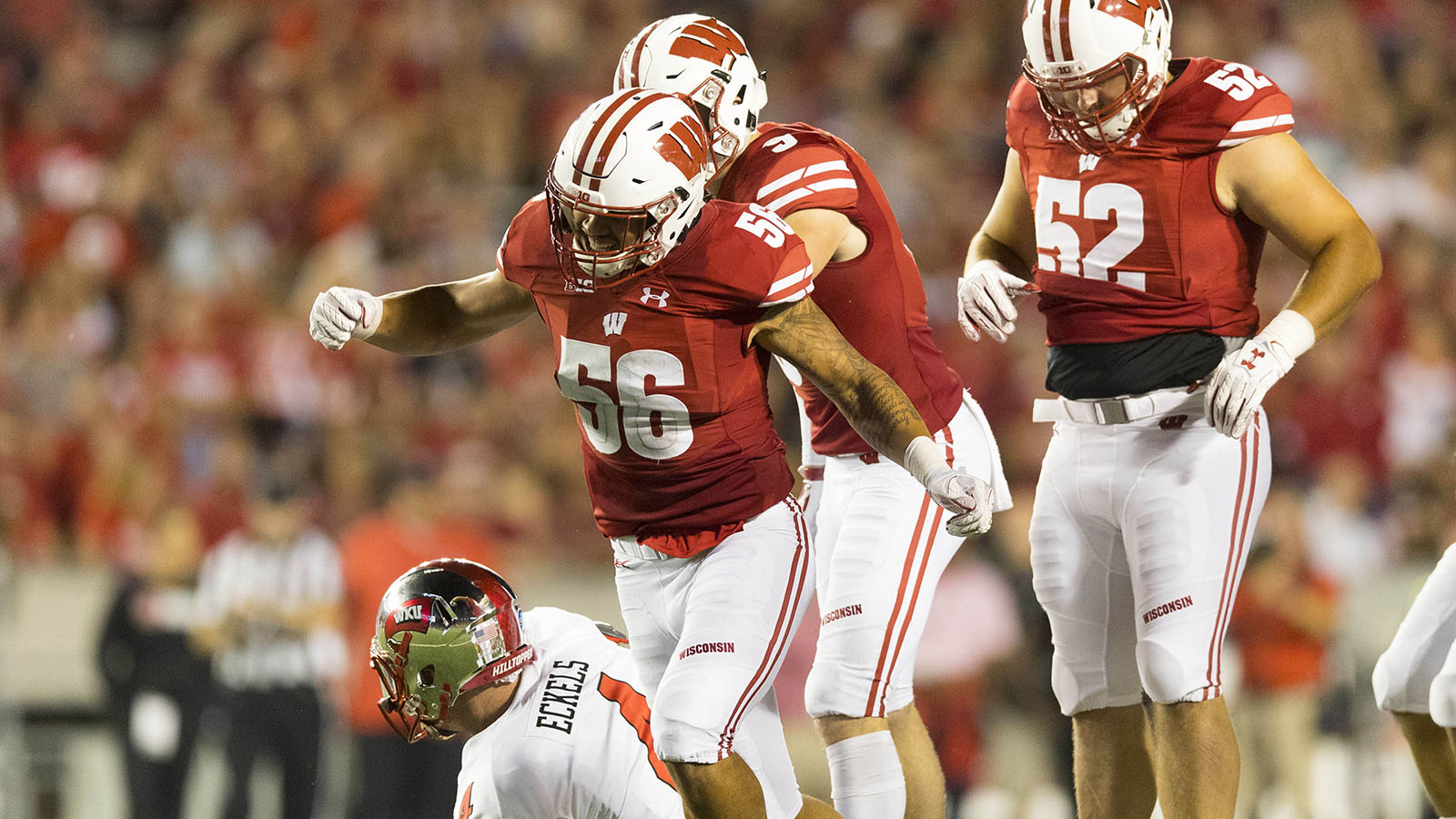 Aug 31, 2018; Madison, WI, USA; Wisconsin Badgers linebacker Zack Baun (56) celebrates after tackling Western Kentucky Hilltoppers quarterback Drew Eckels (4) during the third quarter at Camp Randall Stadium. Mandatory Credit: Jeff Hanisch-USA TODAY Sports