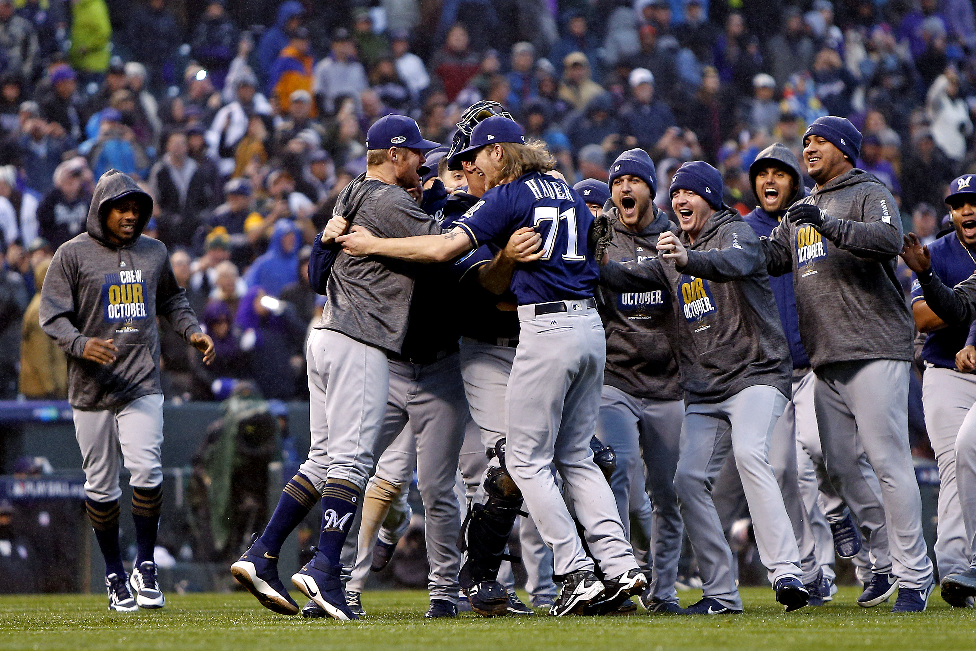Oct 7, 2018; Denver, CO, USA; The Milwaukee Brewers celebrates after beating the Colorado Rockies in game three of the 2018 NLDS playoff baseball series at Coors Field. Mandatory Credit: Russell Lansford-USA TODAY Sports