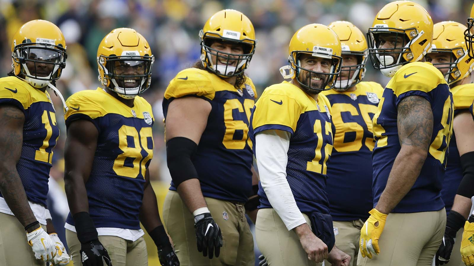 Green Bay Packers' Aaron Rodgers and teammates smile at fans during a break in the second half of an NFL football game Sunday, Sept. 30, 2018, in Green Bay, Wis. The Packers won 22-0. (AP Photo/Jeffrey Phelps)