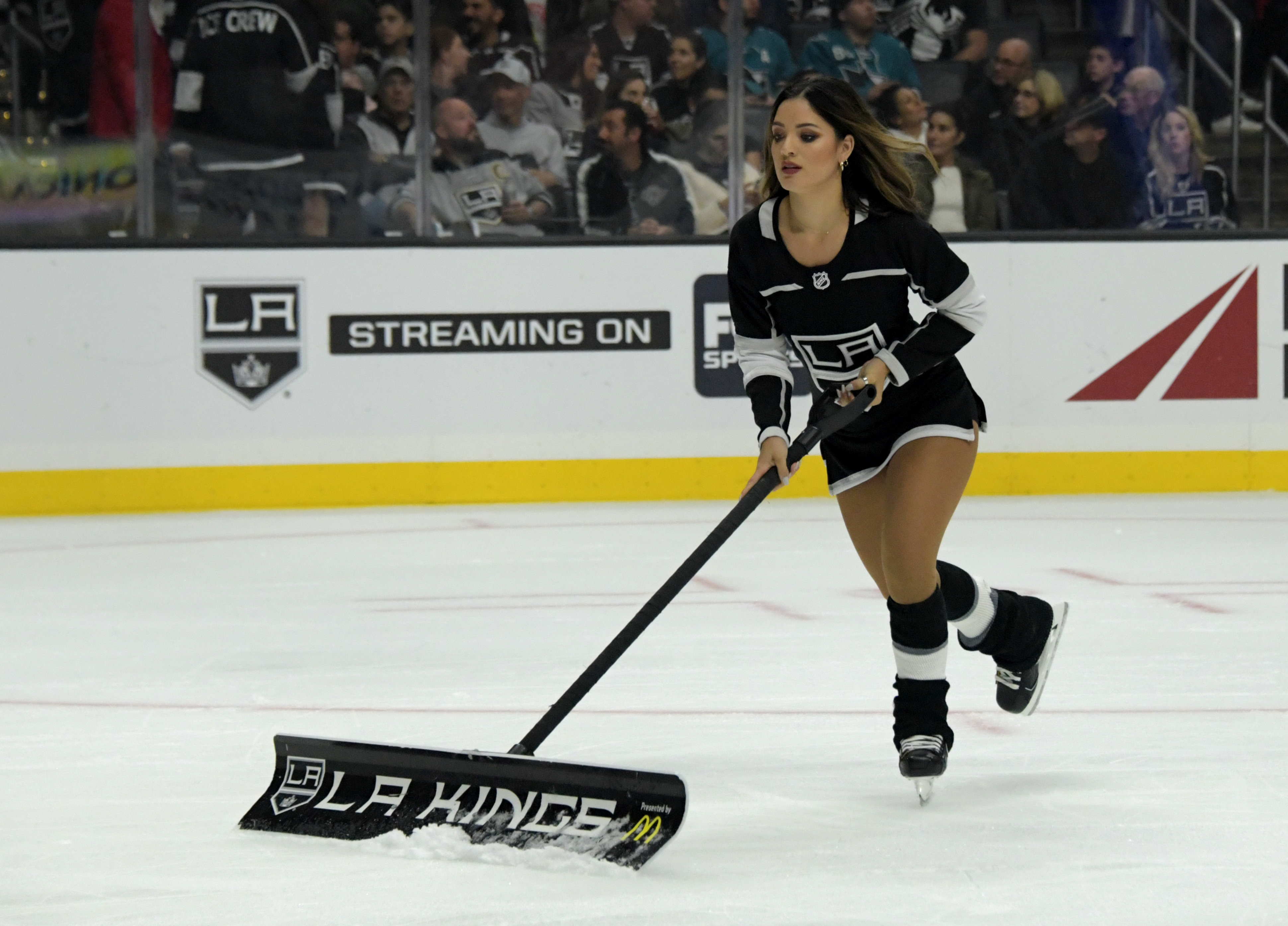 Oct 5, 2018; Los Angeles, CA, USA; Los Angeles Kings ice girl Pamela Rebora clears the surface in the first period against San Jose Sharks at Staples Center. Mandatory Credit: Kirby Lee-USA TODAY Sports