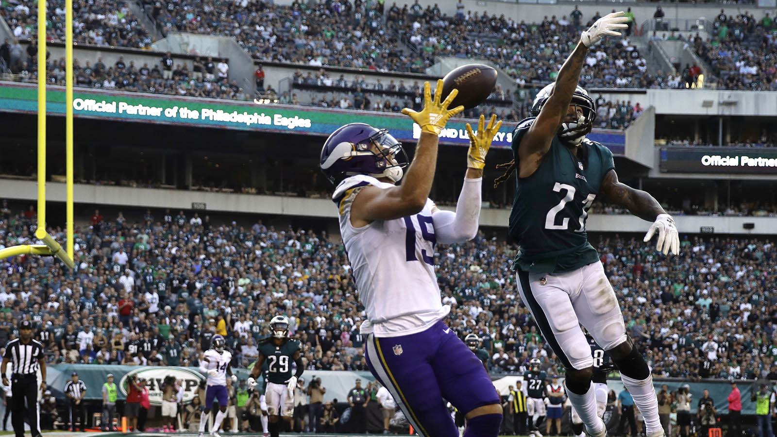 Minnesota Vikings receiver Adam Thielen catches a touchdown against Philadelphia Eagles defender Ronald Darby during the first half.