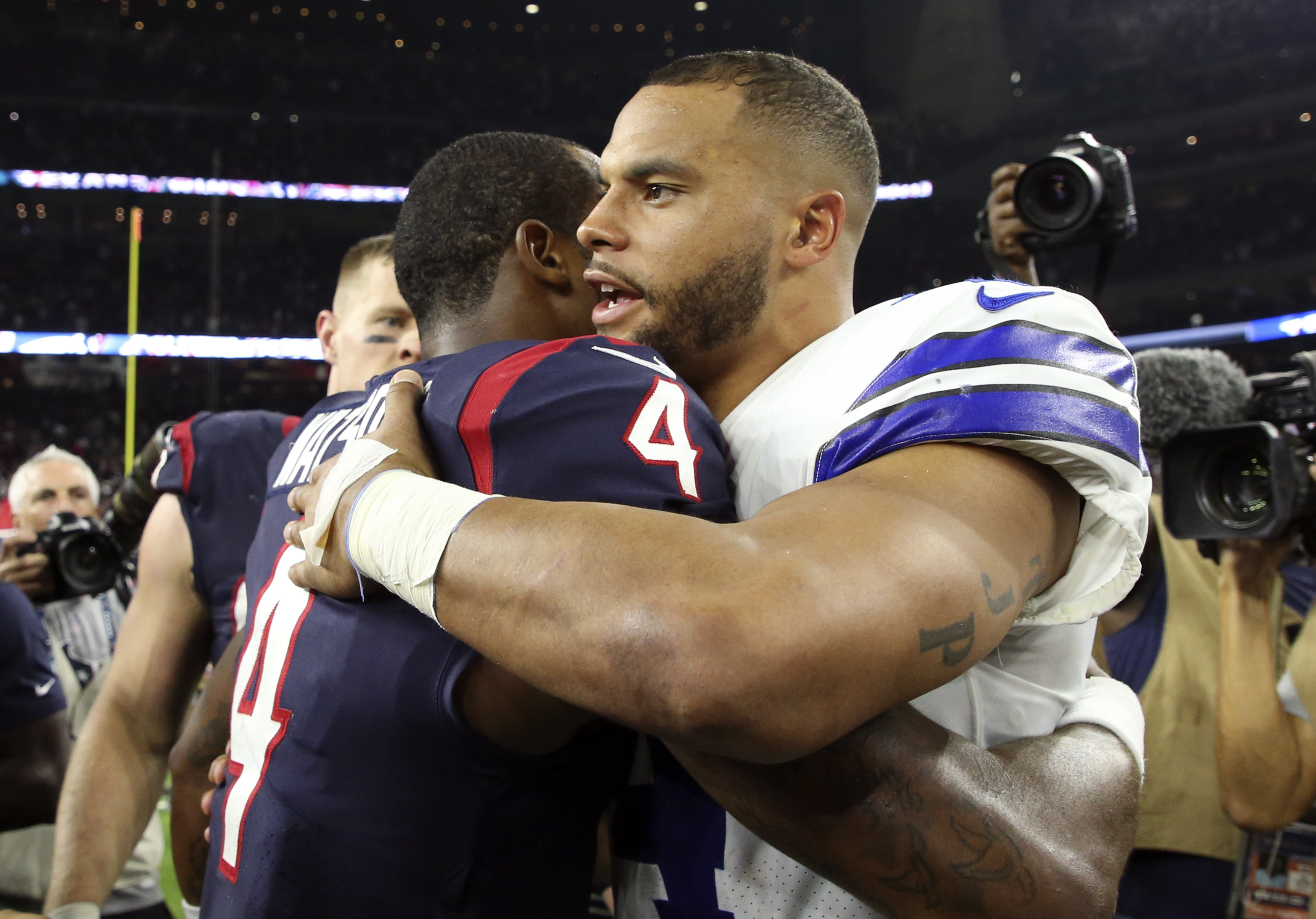 Oct 7, 2018; Houston, TX, USA; Dallas Cowboys quarterback Dak Prescott (4) and Houston Texans quarterback Deshaun Watson (4) hug after the game at NRG Stadium. Mandatory Credit: Kevin Jairaj-USA TODAY Sports