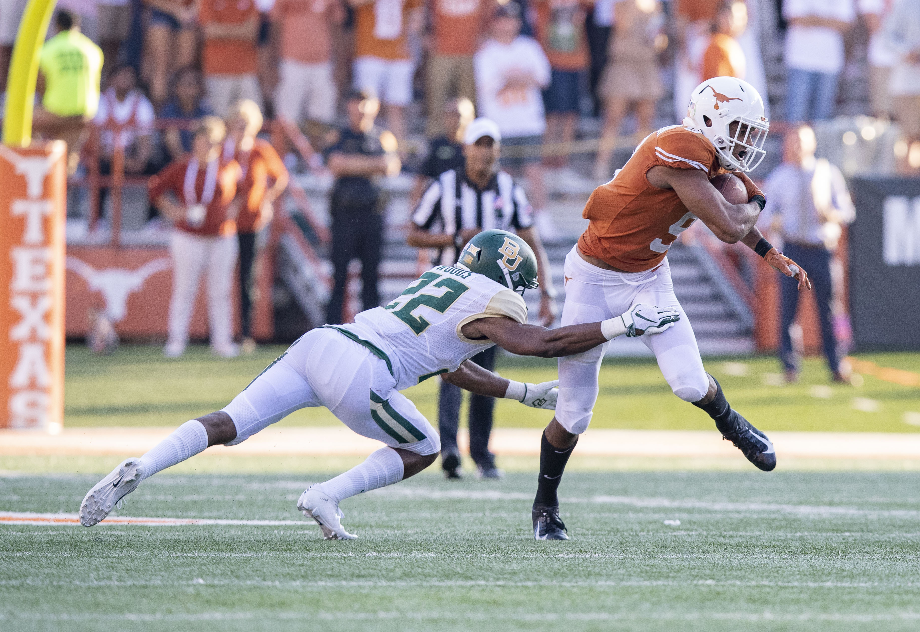 Oct 13, 2018; Austin, TX, USA; Texas Longhorns wide receiver Collin Johnson (9) spins away from Baylor Bears safety JT Woods (22) during the fourth quarter at Darrell K Royal-Texas Memorial Stadium. Mandatory Credit: John Gutierrez-USA TODAY Sports