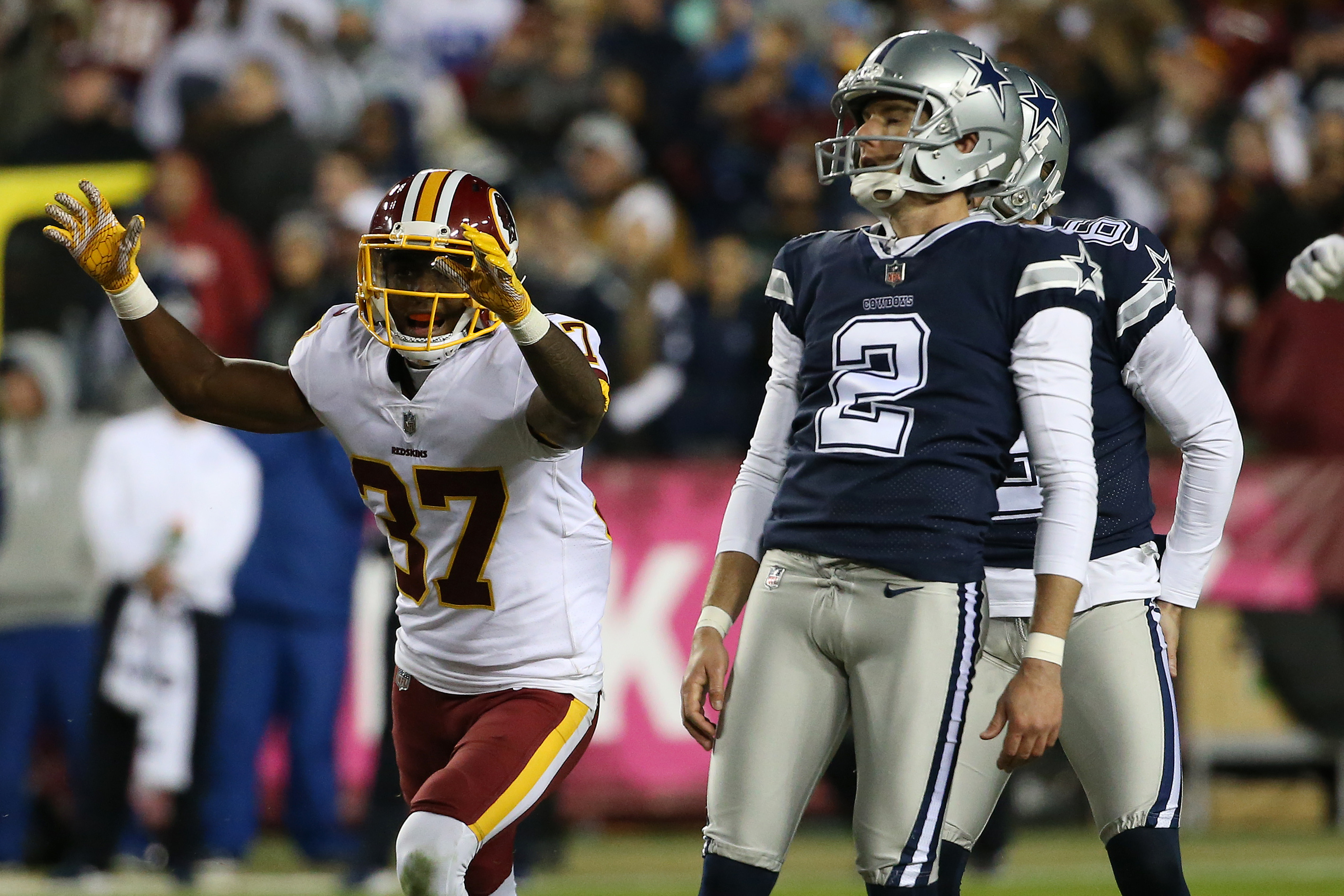 Oct 21, 2018; Landover, MD, USA; Washington Redskins defensive back Greg Stroman (37) celebrates as Dallas Cowboys kicker Brett Maher (2) watches after missing a game-tying field goal attempt on the final play of the fourth quarter at FedEx Field. Mandatory Credit: Geoff Burke-USA TODAY Sports