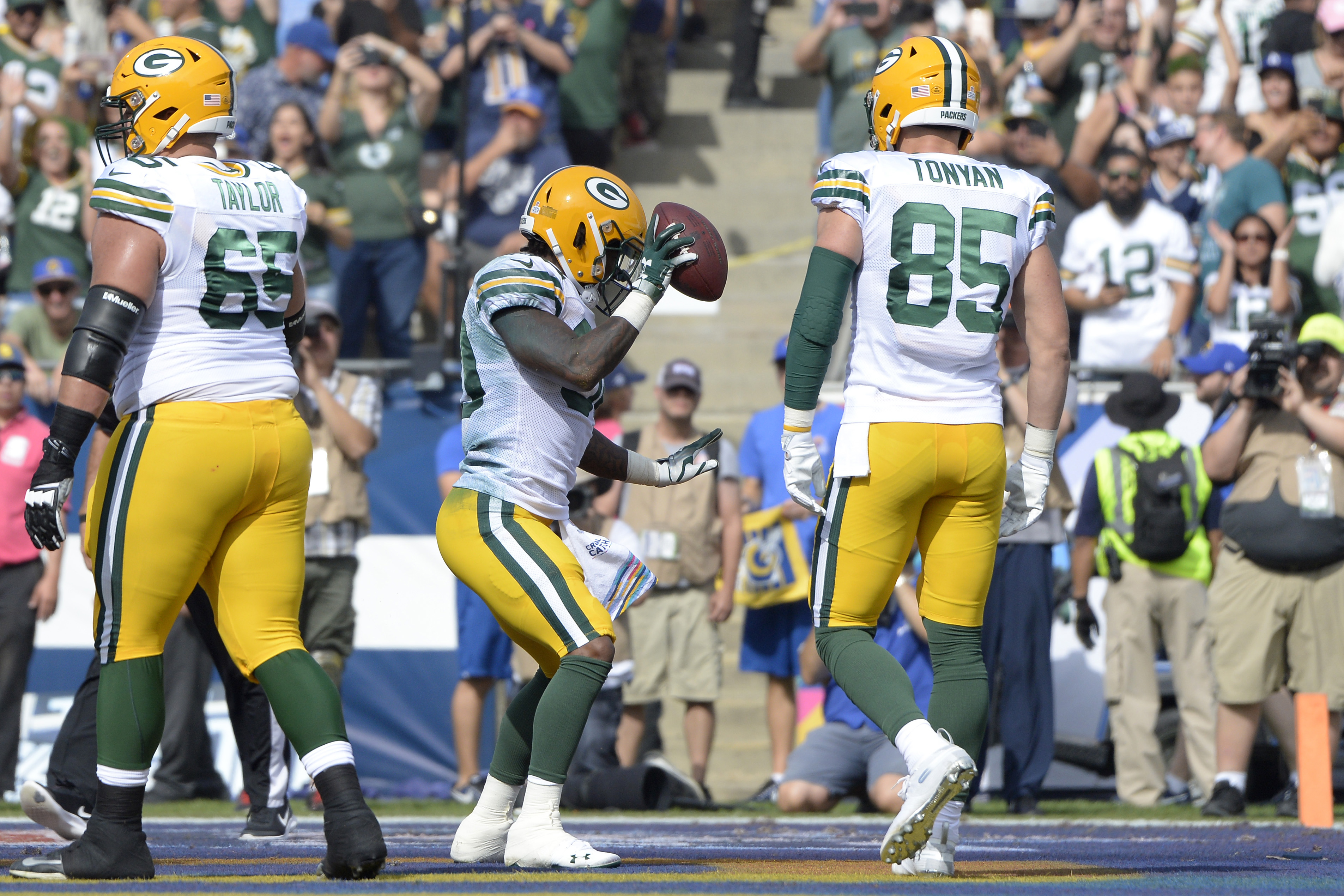 Oct 28, 2018; Los Angeles, CA, USA; Green Bay Packers running back Jamaal Williams (center) celebrates a first quarter touchdown  against the Los Angeles Rams at Los Angeles Memorial Coliseum. Mandatory Credit: Jake Roth-USA TODAY Sports