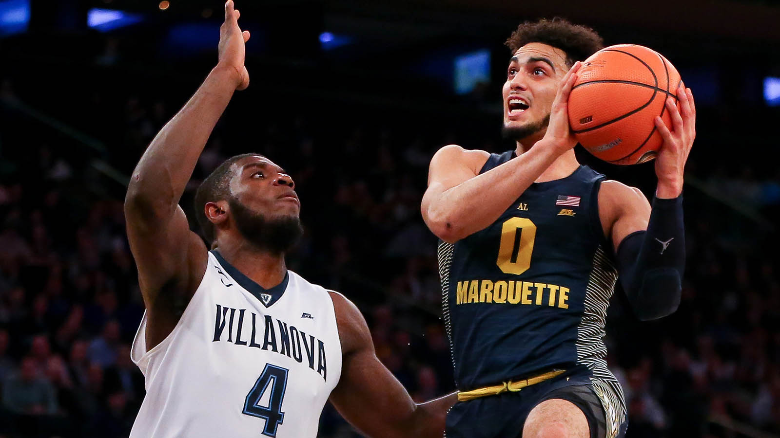 Mar 8, 2018; New York, NY, USA; Marquette Golden Eagles guard Markus Howard (0) drives to the basket against Villanova Wildcats forward Eric Paschall (4) during the first half in the Big East Tournament quarterfinals at Madison Square Garden. Mandatory Credit: Vincent Carchietta-USA TODAY Sports