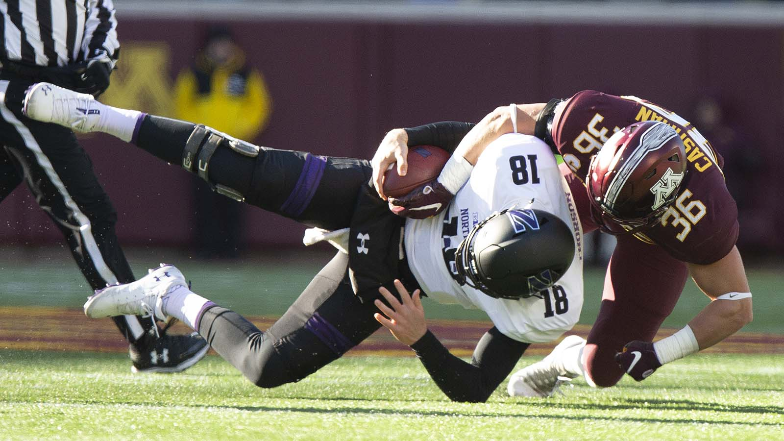 Northwestern quarterback Clayton Thorson is sacked by Minnesota's Blake Cashman during the first half of an NCAA college football game Saturday, Nov. 17, 2018, in Minneapolis. (AP Photo/Stacy Bengs)