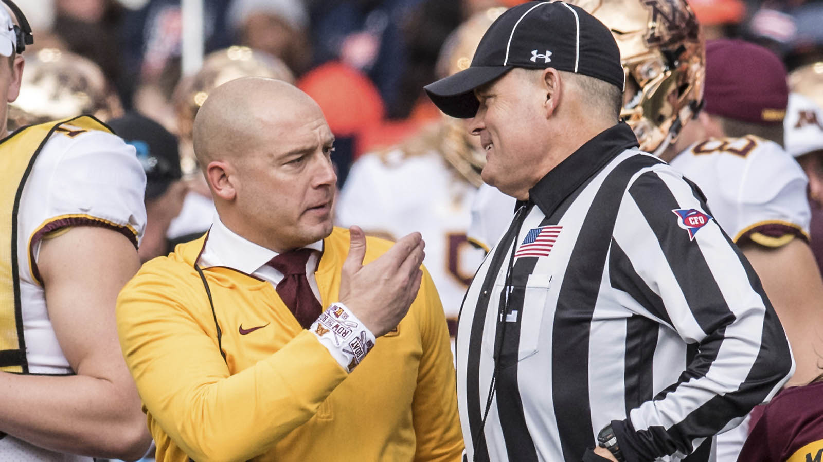 Minnesota Head Coach P.J. Fleck talks with an official in the first half of a NCAA college football game against Illinois Saturday, Nov. 3, 2018, in Champaign, Ill. (AP Photo/Holly Hart)