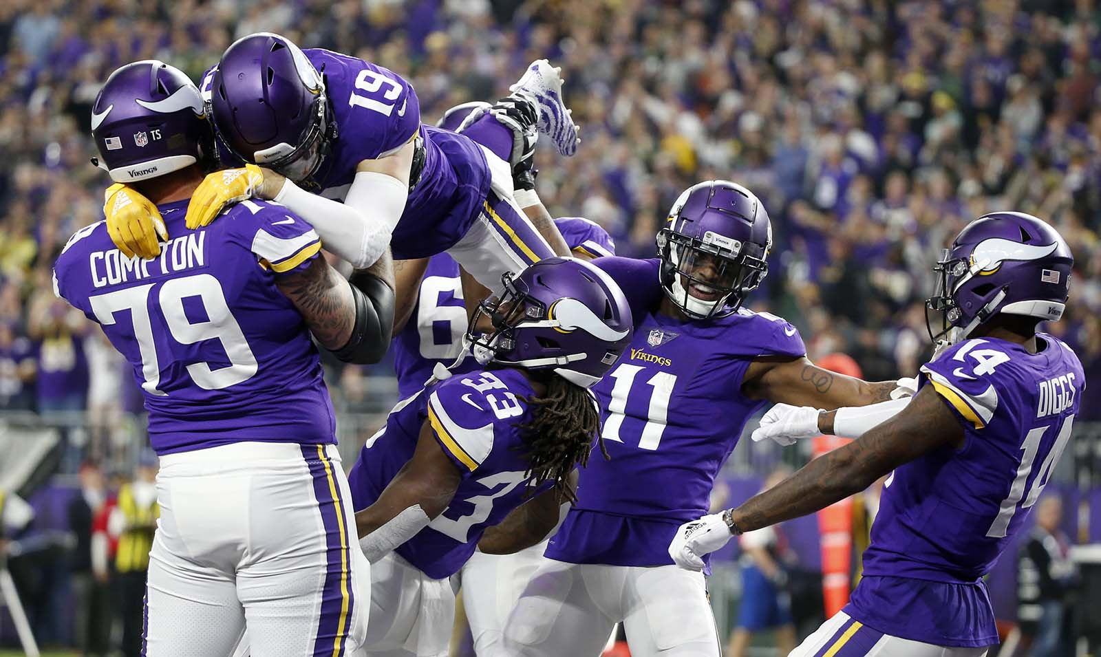 Minnesota Vikings running back Dalvin Cook (33) celebrates with teammates after catching a 26-yard touchdown pass during the first half of an NFL football game against the Green Bay Packers, Sunday, Nov. 25, 2018, in Minneapolis. (AP Photo/Bruce Kluckhohn)