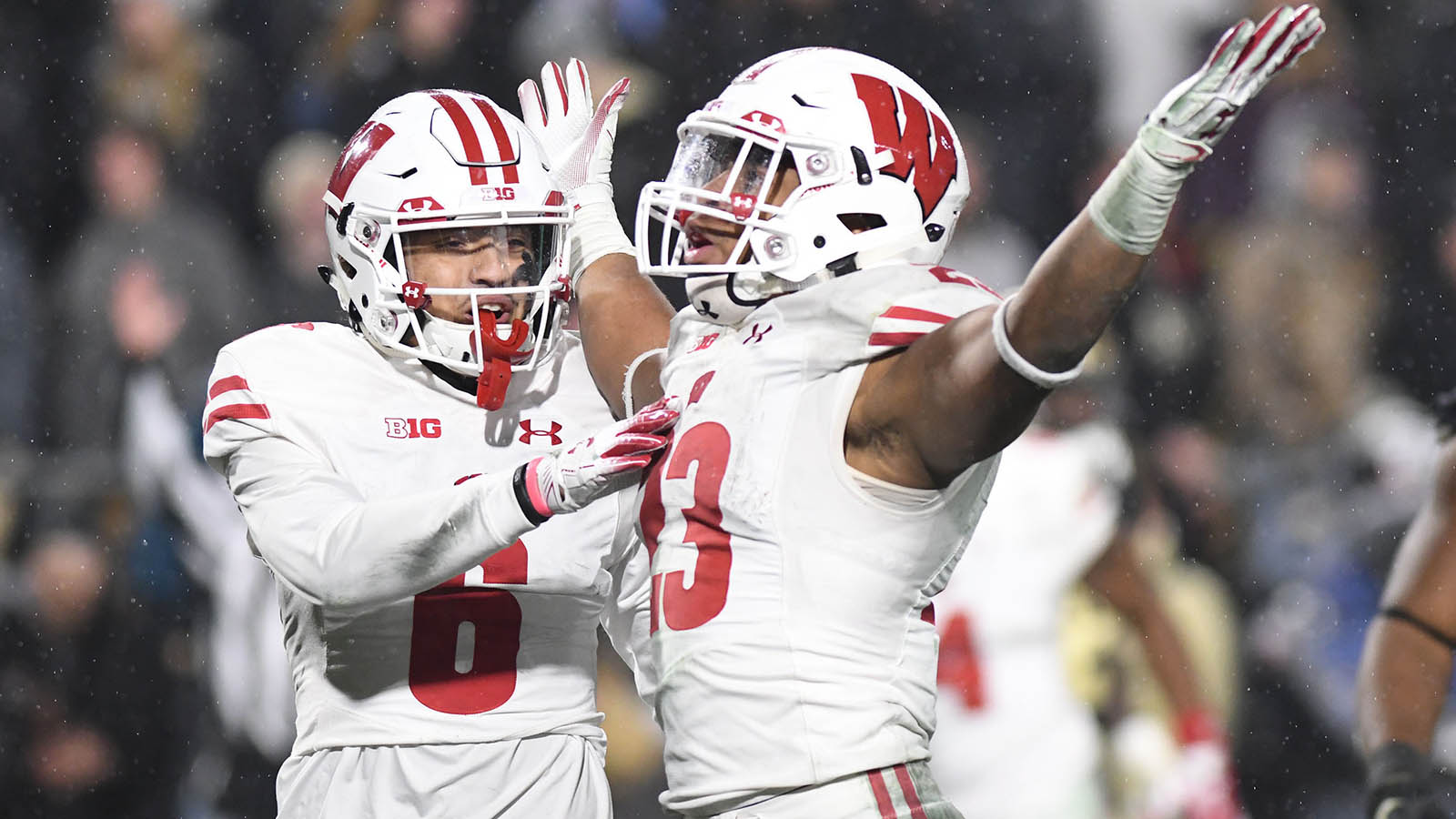 Nov 17, 2018; West Lafayette, IN, USA;  Wisconsin Badgers receiver Danny Davis (6) and running back Jonathon Taylor (23) celebrate after defeating the Purdue Boilermakers, 47-44, in triple overtime at Ross-Ade Stadium. Mandatory Credit: Thomas J. Russo-USA TODAY Sports