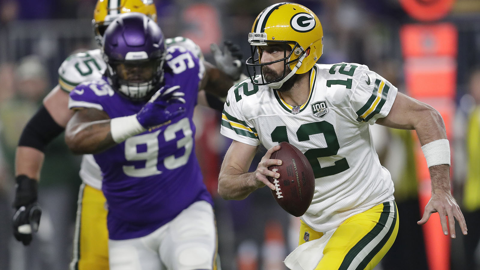 Nov 25, 2018; Minneapolis, MN, USA; Green Bay Packers quarterback Aaron Rodgers (12) runs with the ball as Minnesota Vikings' Sheldon Richardson (93) chases in the first quarter during at U.S. Bank Stadium. Mandatory Credit: Dan Powers via USA TODAY NETWORK