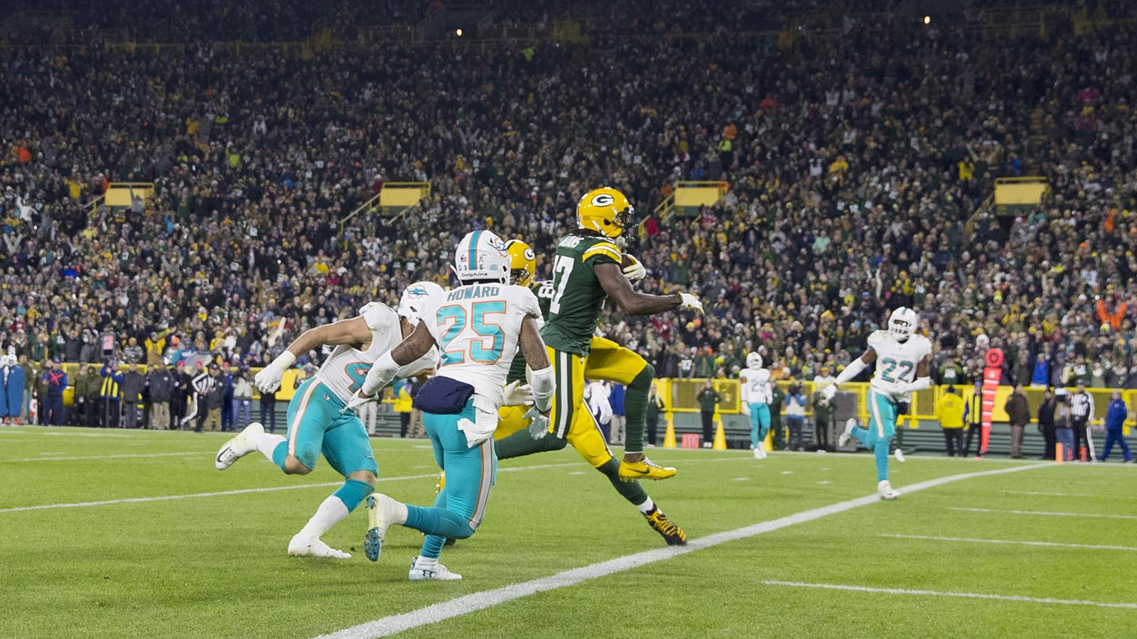 Nov 11, 2018; Green Bay, WI, USA; Green Bay Packers wide receiver Davante Adams (17) scores a touchdown pass during the third quarter against the Miami Dolphins at Lambeau Field. Mandatory Credit: Jeff Hanisch-USA TODAY Sports