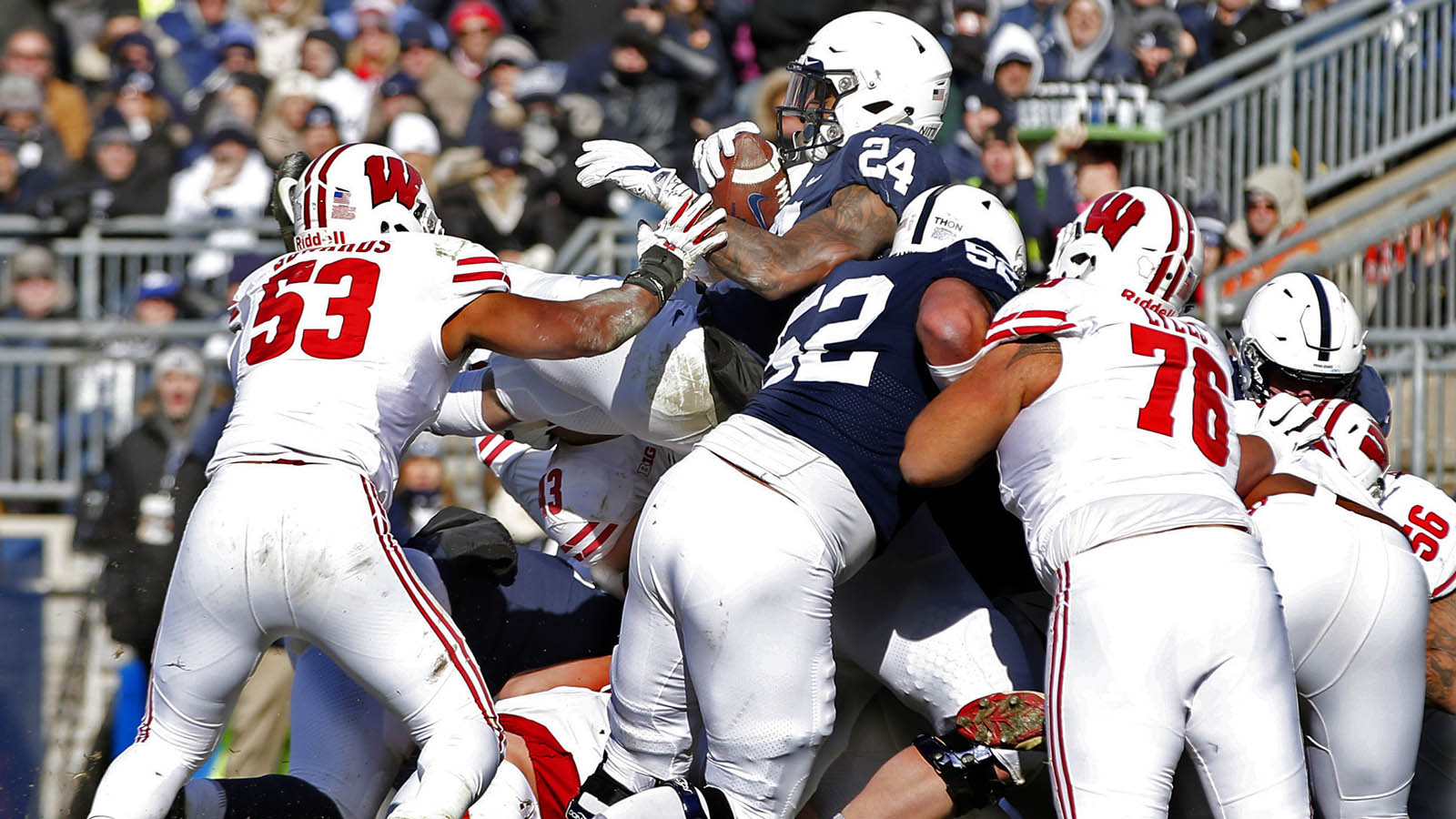 Penn State's Miles Sanders (24) dives over the line to score against Wisconsin during the first half of an NCAA college football game in State College, Pa., Saturday, Nov. 10, 2018. (AP Photo/Chris Knight)