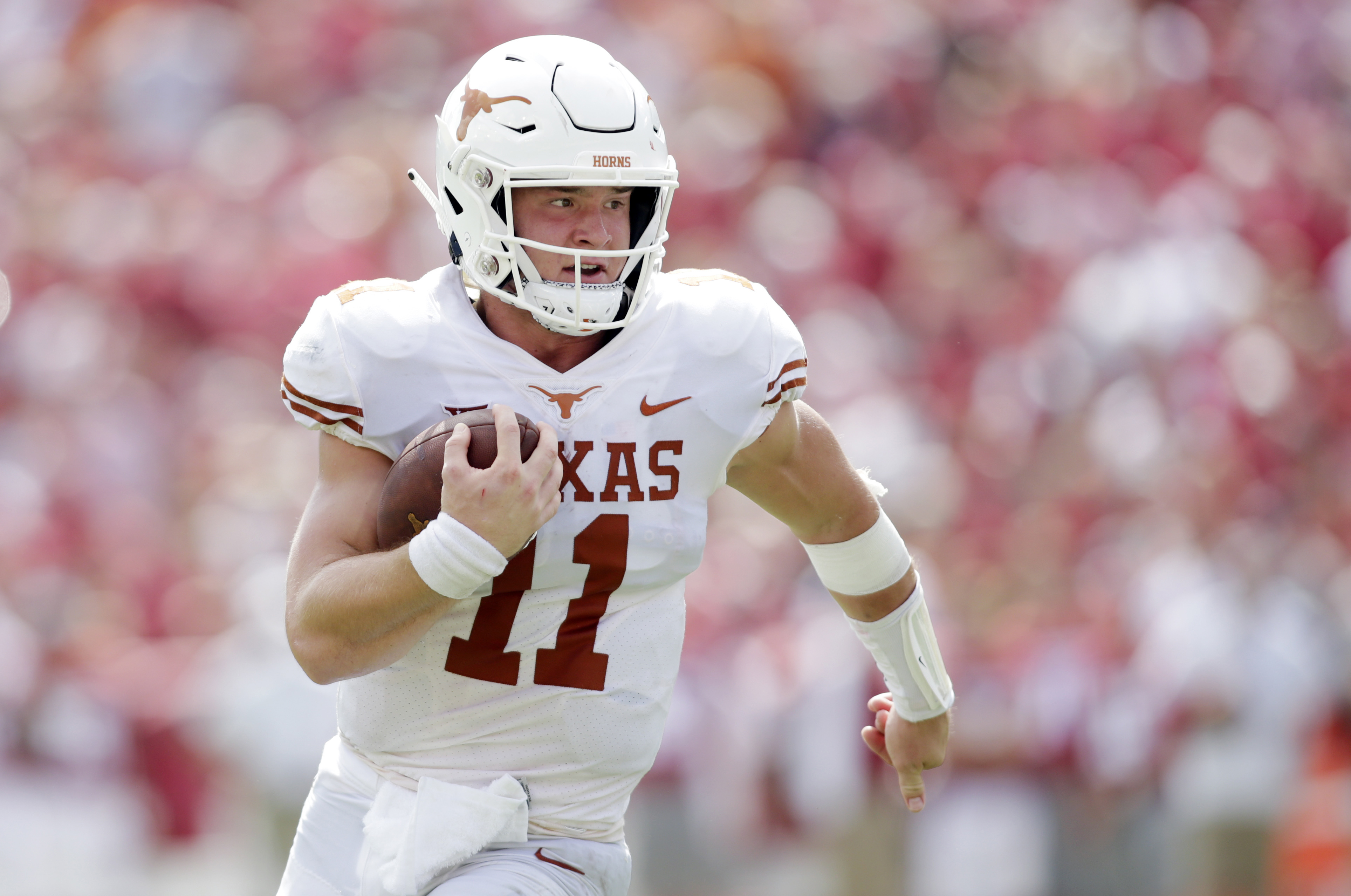 Oct 6, 2018; Dallas, TX, USA; Texas Longhorns quarterback Sam Ehlinger (11) runs for a touchdown in the third quarter against the Oklahoma Sooners at the Cotton Bowl. Mandatory Credit: Tim Heitman-USA TODAY Sports