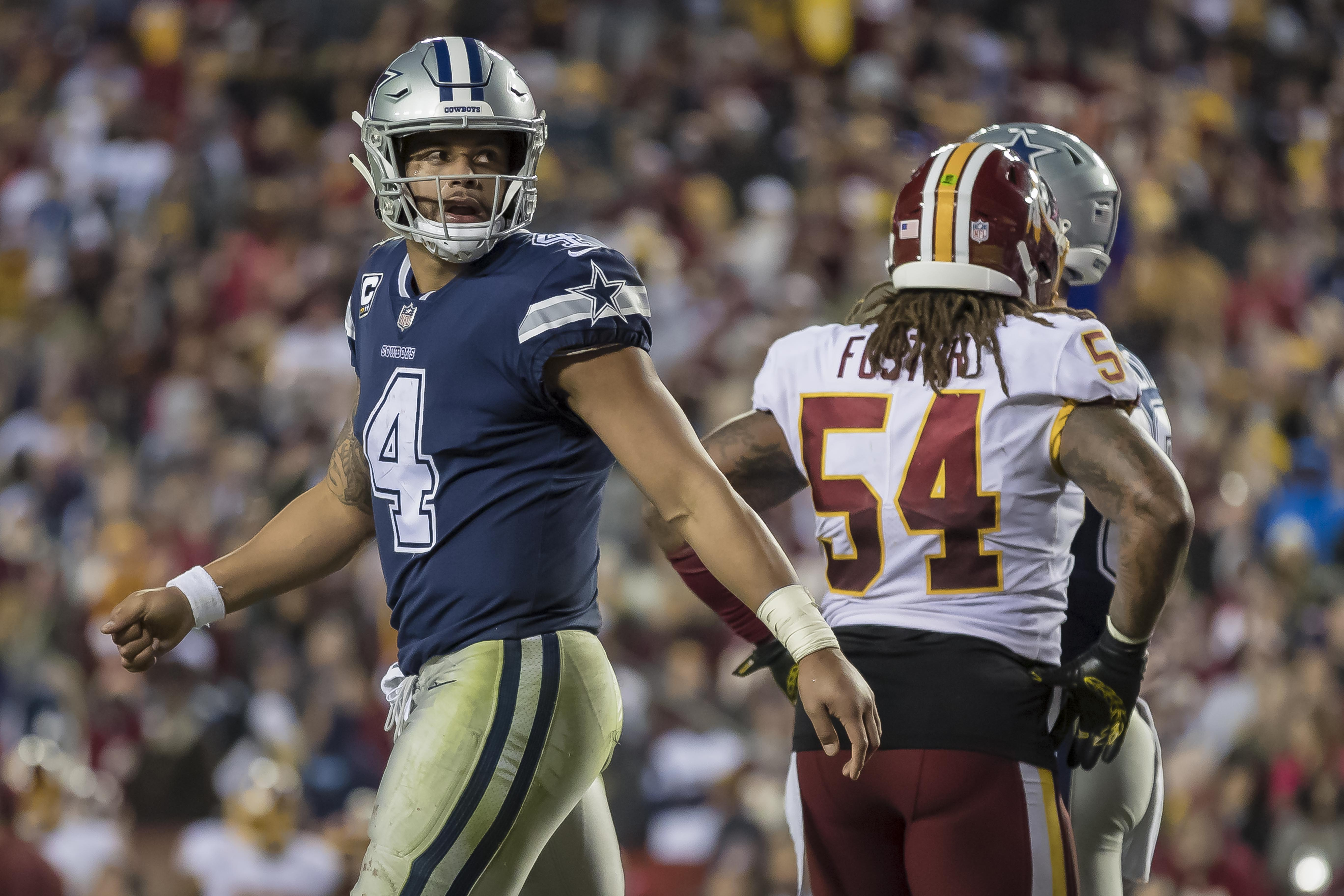 Oct 21, 2018; Landover, MD, USA; Dallas Cowboys quarterback Dak Prescott (4) looks on after scoring a touchdown against the Washington Redskins during the second half at FedEx Field. Mandatory Credit: Scott Taetsch-USA TODAY Sports
