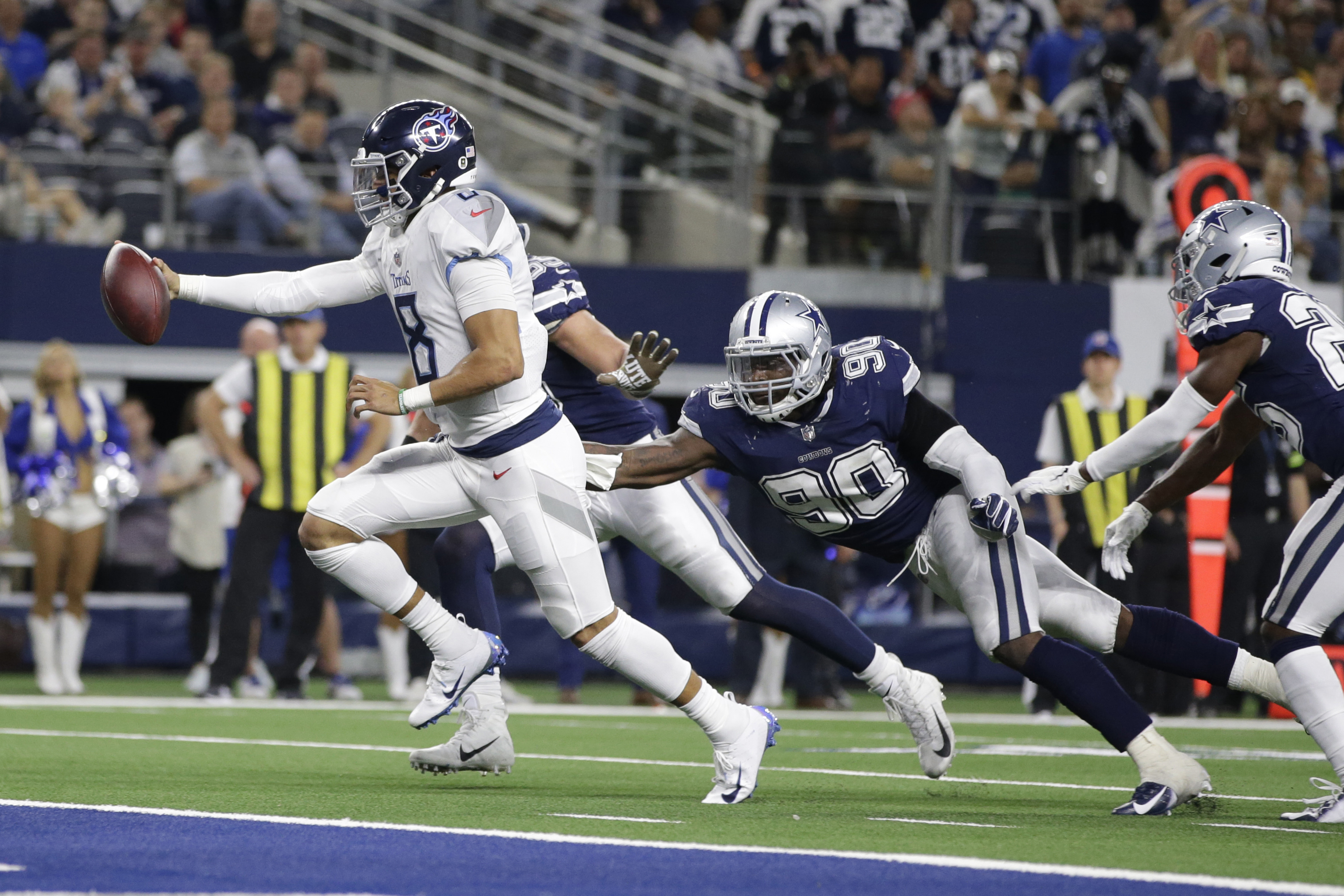 Nov 5, 2018; Arlington, TX, USA; Tennessee Titans quarterback Marcus Mariota (8) scores a touchdown in the third quarter against the Dallas Cowboys at AT&T Stadium. Mandatory Credit: Tim Heitman-USA TODAY Sports