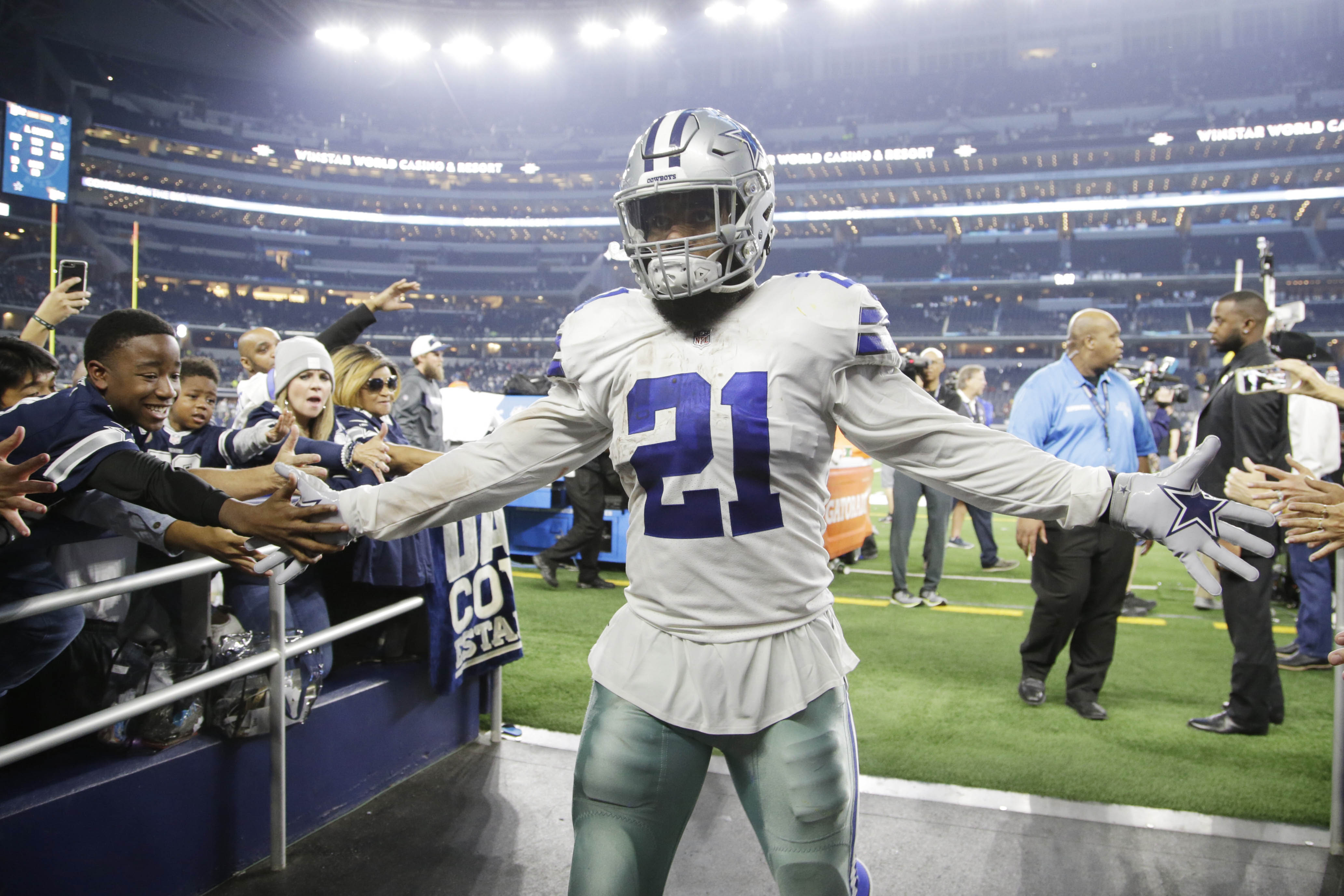 Nov 22, 2018; Arlington, TX, USA; Dallas Cowboys running back Ezekiel Elliott (21) is congratulated by fans as he leaves the field after the game against the Washington Redskins at AT&T Stadium. Mandatory Credit: Tim Heitman-USA TODAY Sports