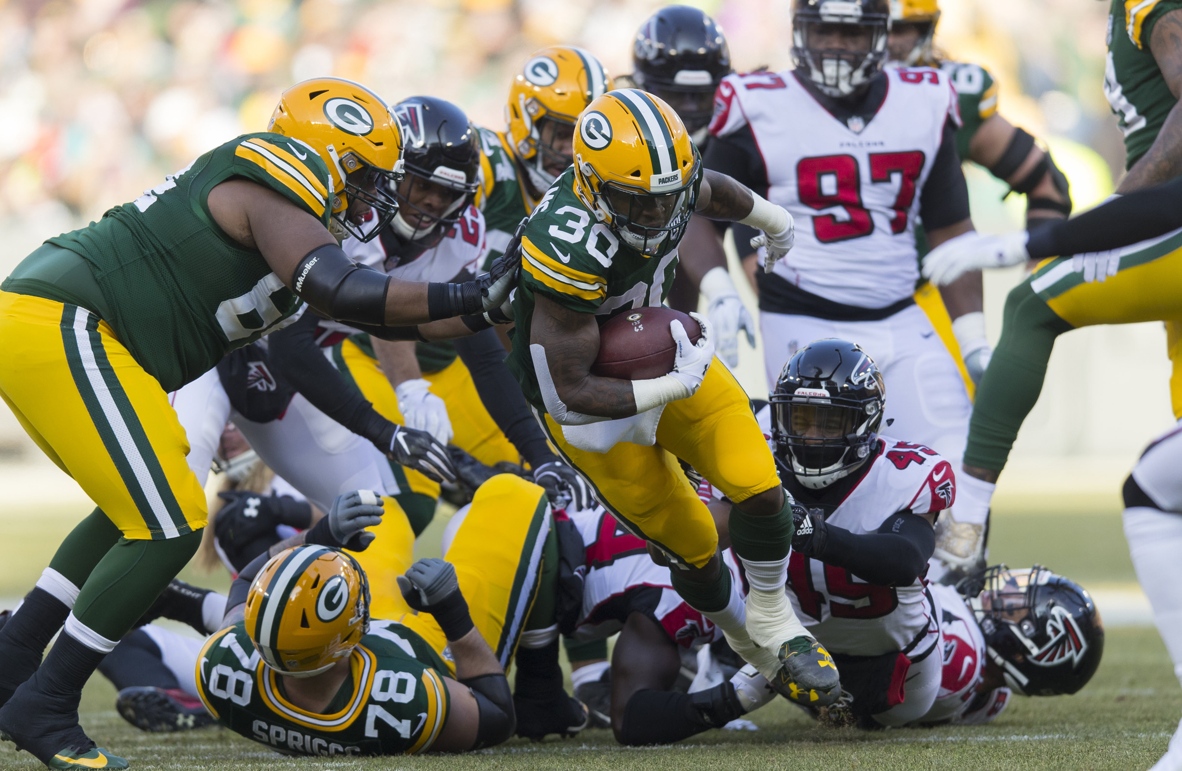 Dec 9, 2018; Green Bay, WI, USA; Green Bay Packers running back Jamaal Williams (30) rushes with the football during the first quarter against the Atlanta Falcons at Lambeau Field. Mandatory Credit: Jeff Hanisch-USA TODAY Sports