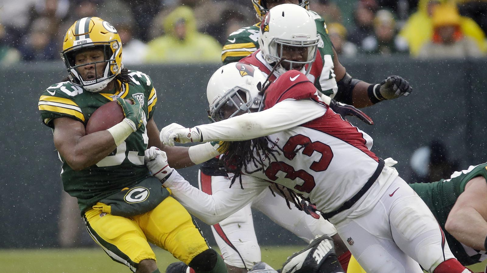 Green Bay Packers running back Aaron Jones is hit during a run by Arizona Cardinals defensive back Tre Boston during the second half.