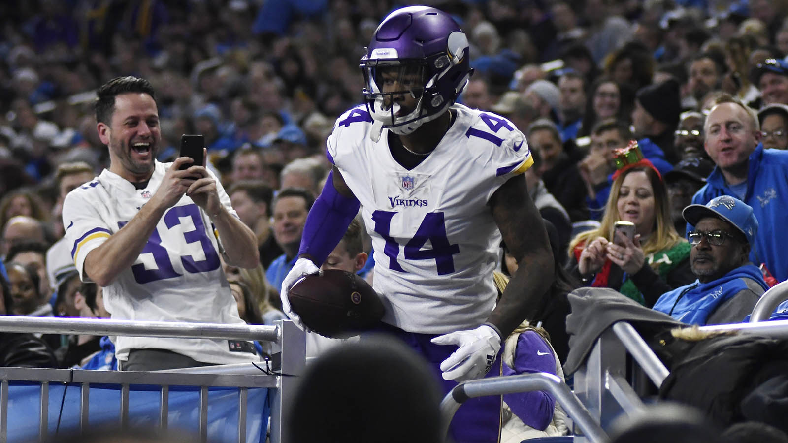 Minnesota Vikings wide receiver Stefon Diggs (14) leaves the stands after scoring a touchdown during the first half of an NFL football game against the Detroit Lions, Sunday, Dec. 23, 2018, in Detroit. (AP Photo/Jose Juarez)