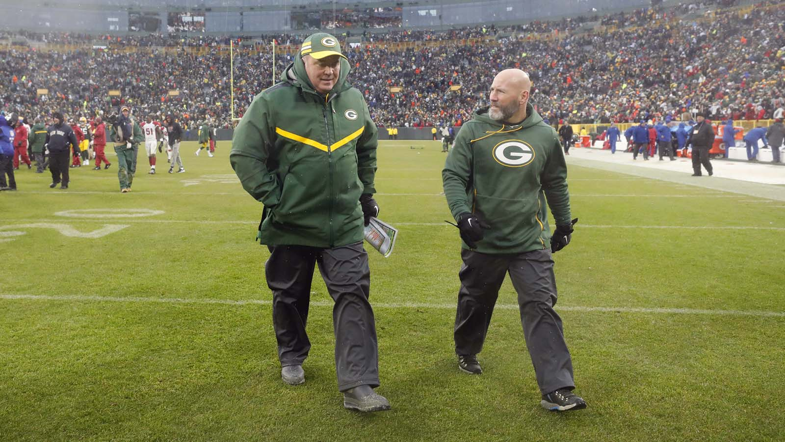 Green Bay Packers head coach Mike McCarthy, left, leaves the field after an NFL football game against the Arizona Cardinals, Sunday, Dec. 2, 2018, in Green Bay, Wis. McCarthy was fired after the game. (AP Photo/Jeffrey Phelps)