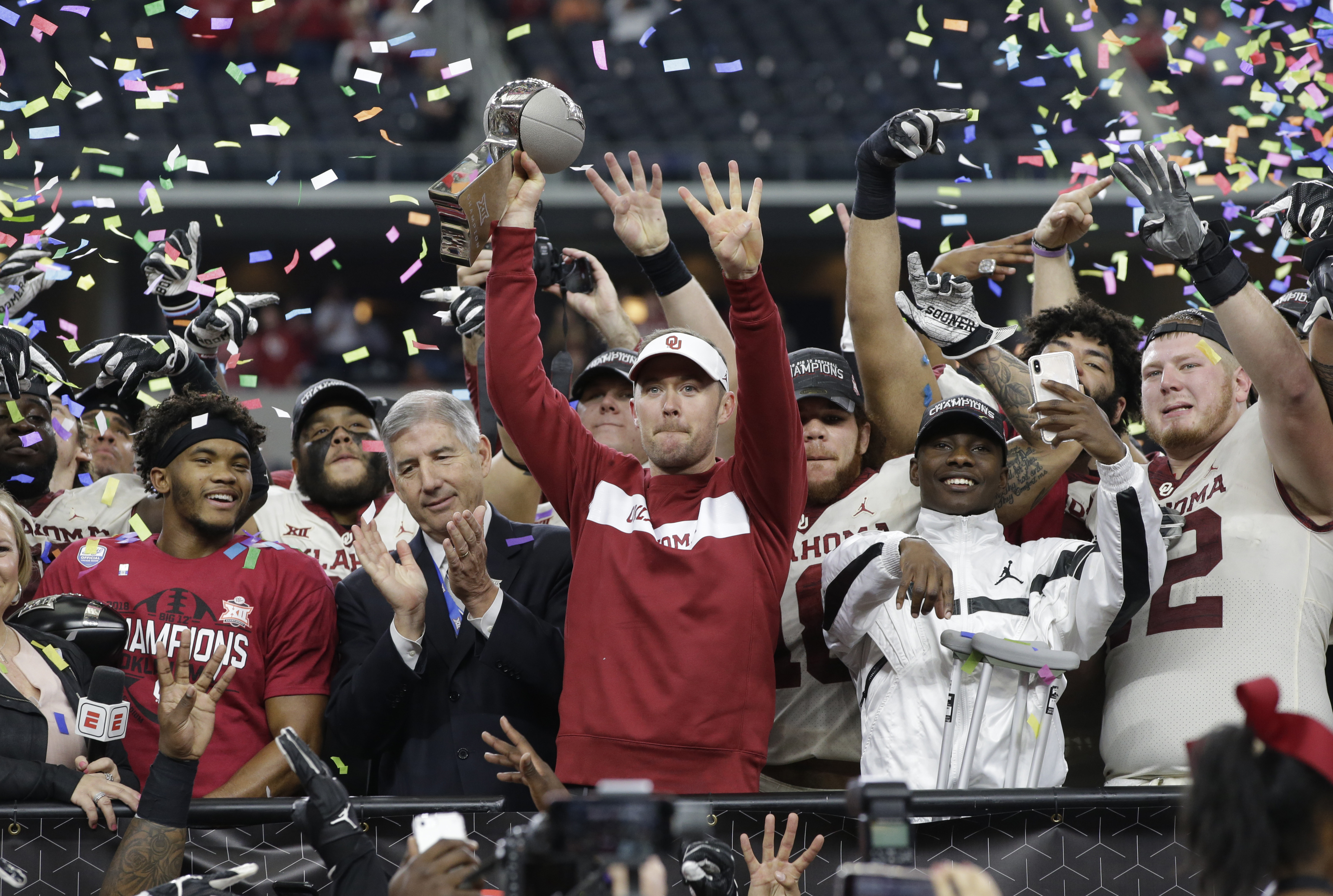 Dec 1, 2018; Arlington, TX, USA; Oklahoma Sooners head coach Lincoln Riley holds up the championship trophy after the game against the Texas Longhorns in the Big 12 championship game at AT&T Stadium. Mandatory Credit: Tim Heitman-USA TODAY Sports