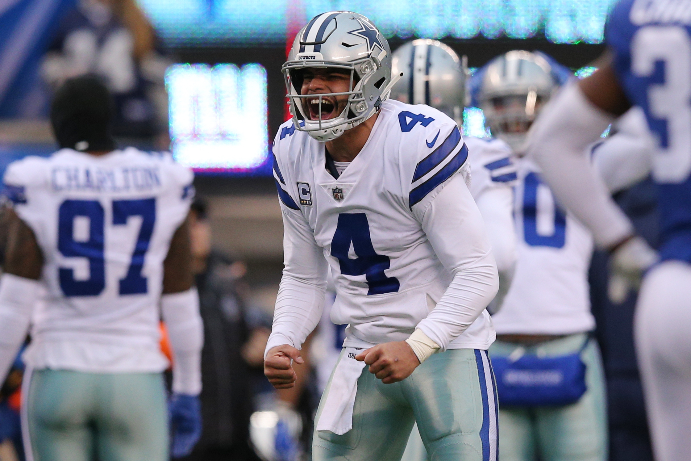 Dec 30, 2018; East Rutherford, NJ, USA; Dallas Cowboys quarterback Dak Prescott (4) reacts after a touchdown against the New York Giants during the third quarter at MetLife Stadium. Mandatory Credit: Brad Penner-USA TODAY Sports