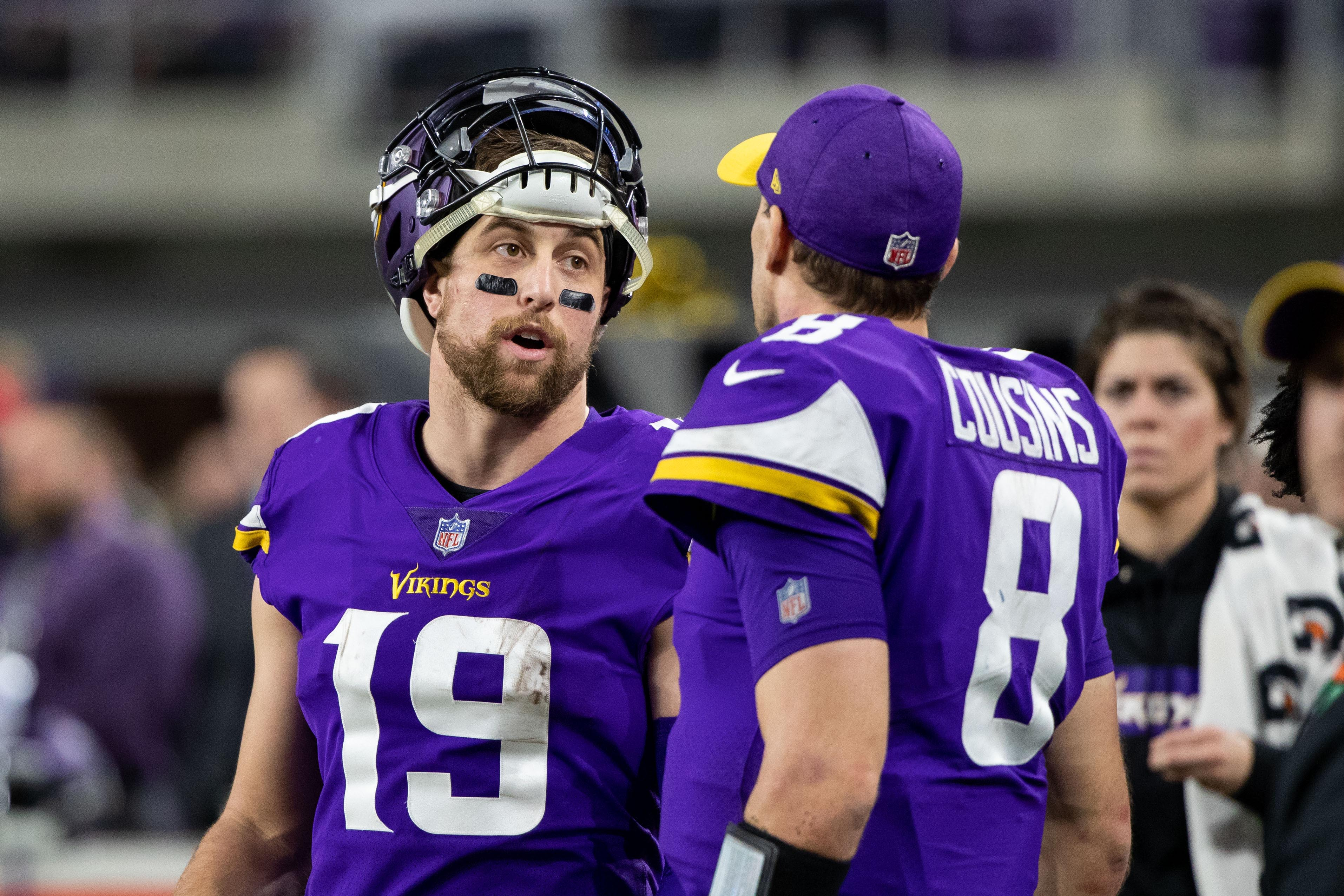 Dec 30, 2018; Minneapolis, MN, USA; Minnesota Vikings wide receiver Adam Thielen (19) talks to quarterback Kirk Cousins (8) on the sidelines in the fourth quarter against Chicago Bears at U.S. Bank Stadium. Mandatory Credit: Brad Rempel-USA TODAY Sports