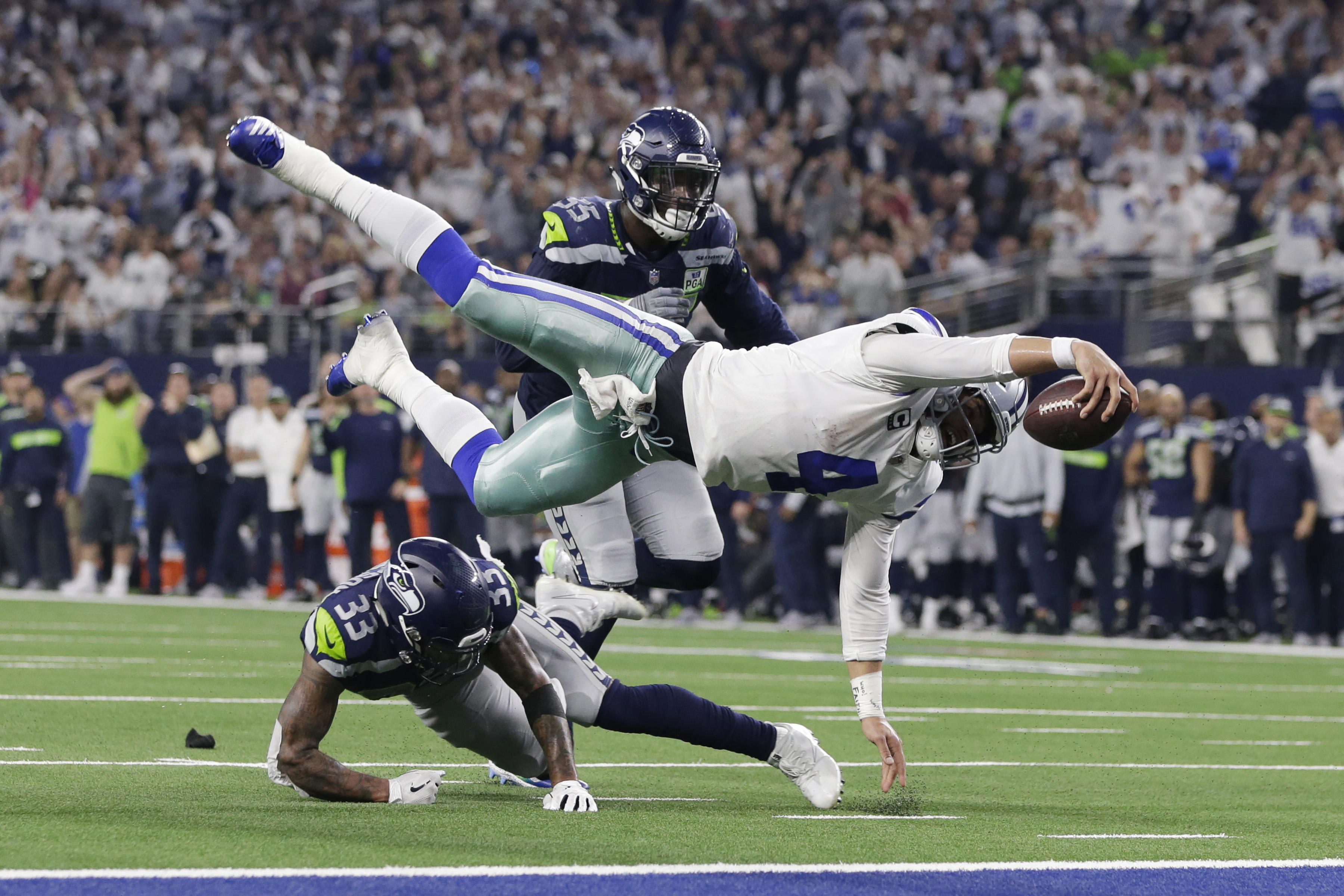 Jan 5, 2019; Arlington, TX, USA; Dallas Cowboys quarterback Dak Prescott (4) is tackled at the one yard line by Seattle Seahawks free safety Tedric Thompson (33) in the fourth quarter in a NFC Wild Card playoff football game at AT&T Stadium. Mandatory Credit: Tim Heitman-USA TODAY Sports