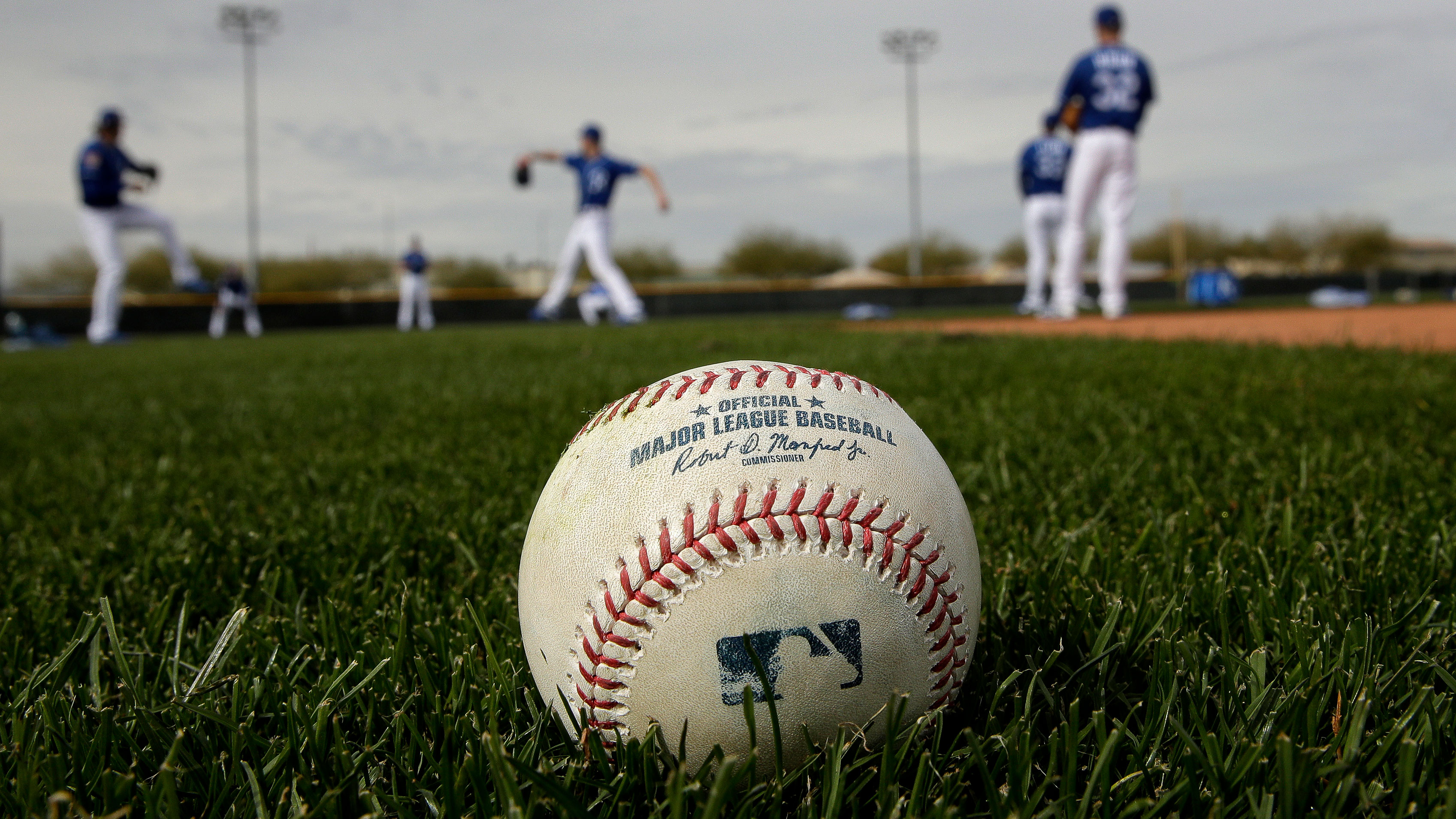 Kansas City Royals pitchers warm up during spring training baseball practice Wednesday, Feb. 13, 2019, in Surprise, Ariz. (AP Photo/Charlie Riedel)