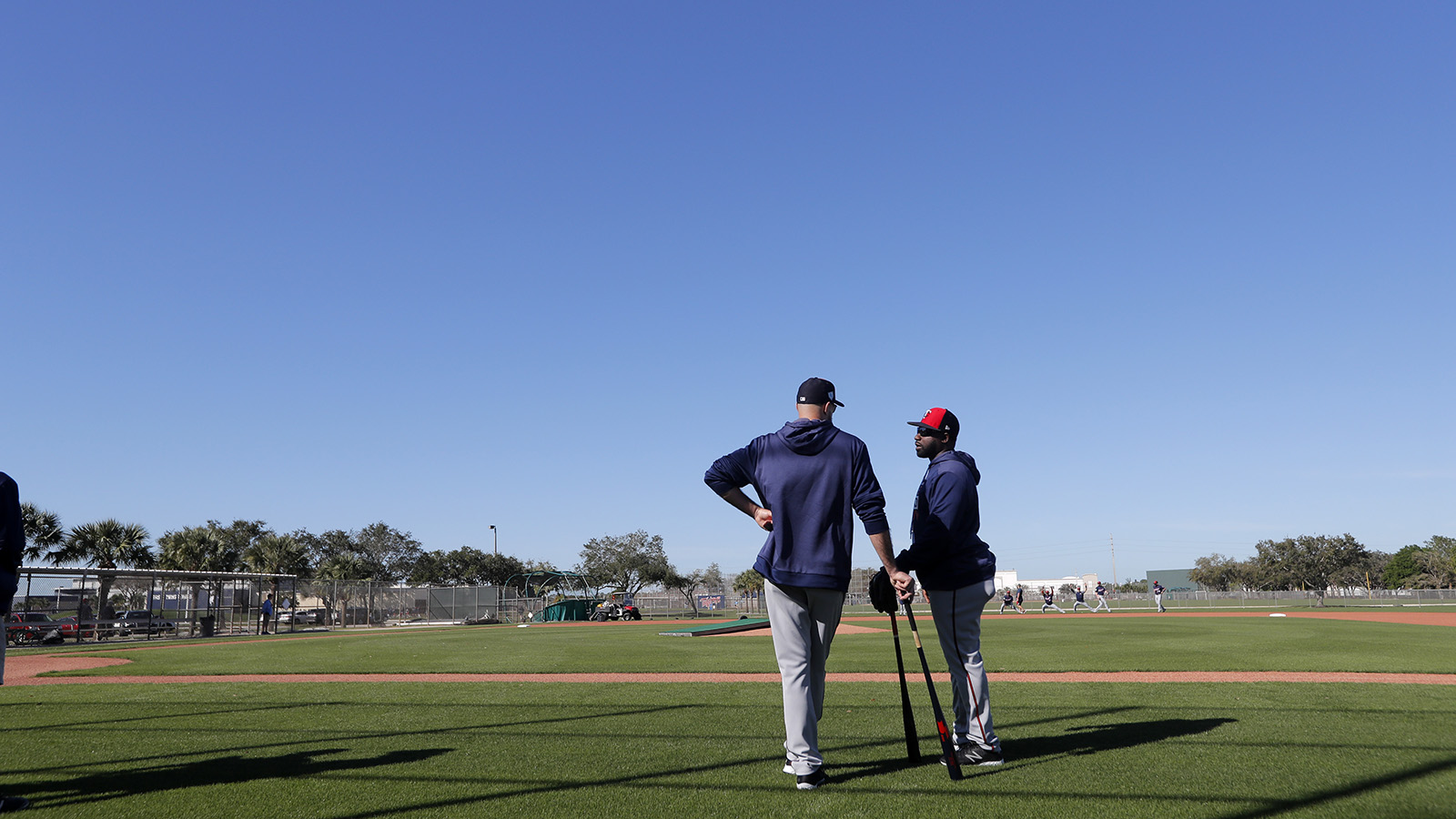 Minnesota Twins manager Rocco Baldelli, left, talks with first base coach Tommy Watkins, as pitchers and catchers report for their first workout at their spring training baseball facility in Ft. Myers, Fla., Thursday, Feb. 14, 2019. (AP Photo/Gerald Herbert)