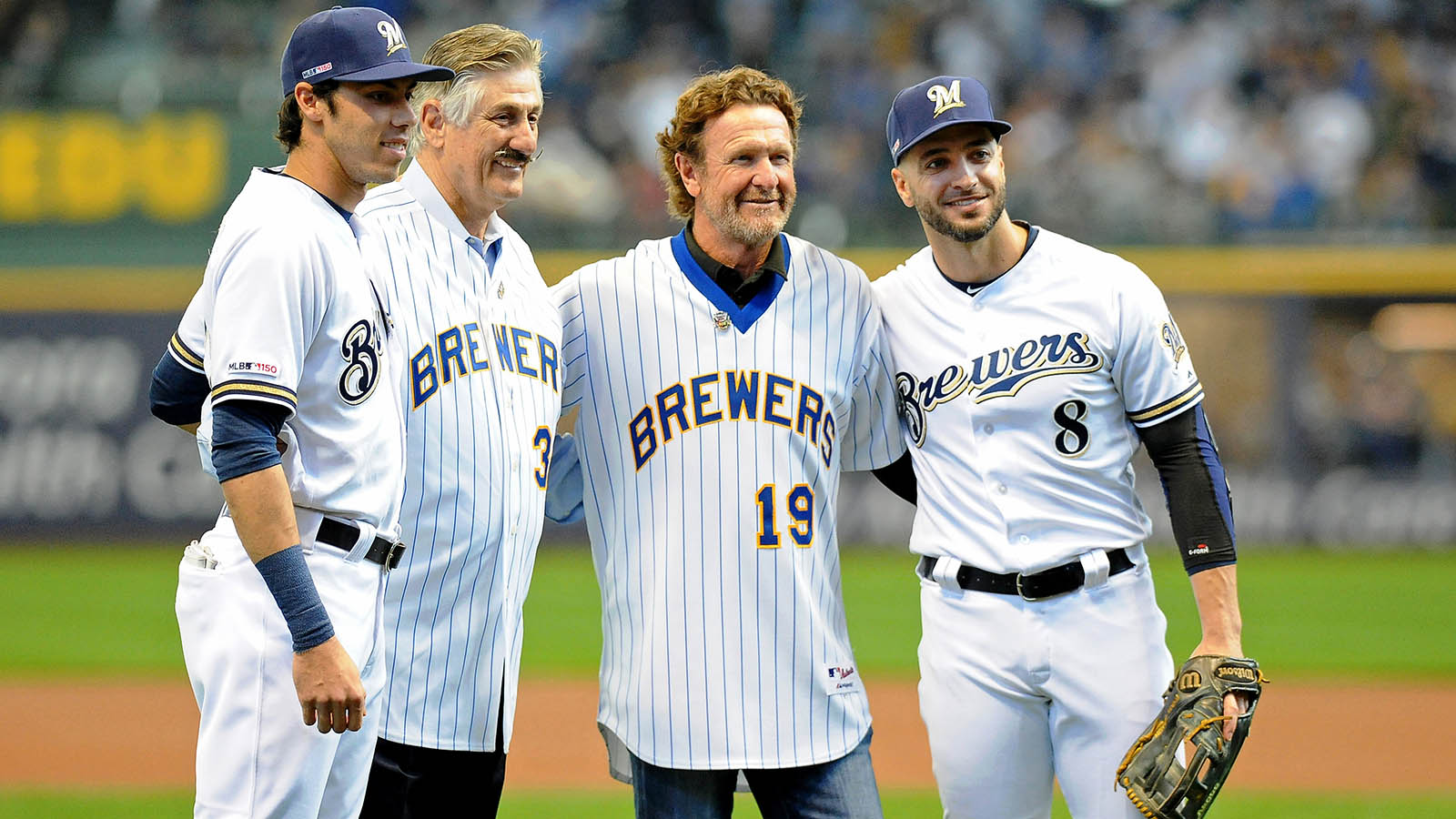 Milwaukee Brewers outfielder Christian Yelich and outfielder Ryan Braun pose for a photo with former Brewers Rollie Fingers and Robin Yount after they threw out ceremonial first pitches before their game against the St. Louis Cardinals at Miller Park. Mandatory Credit: Michael McLoone-USA TODAY Sports