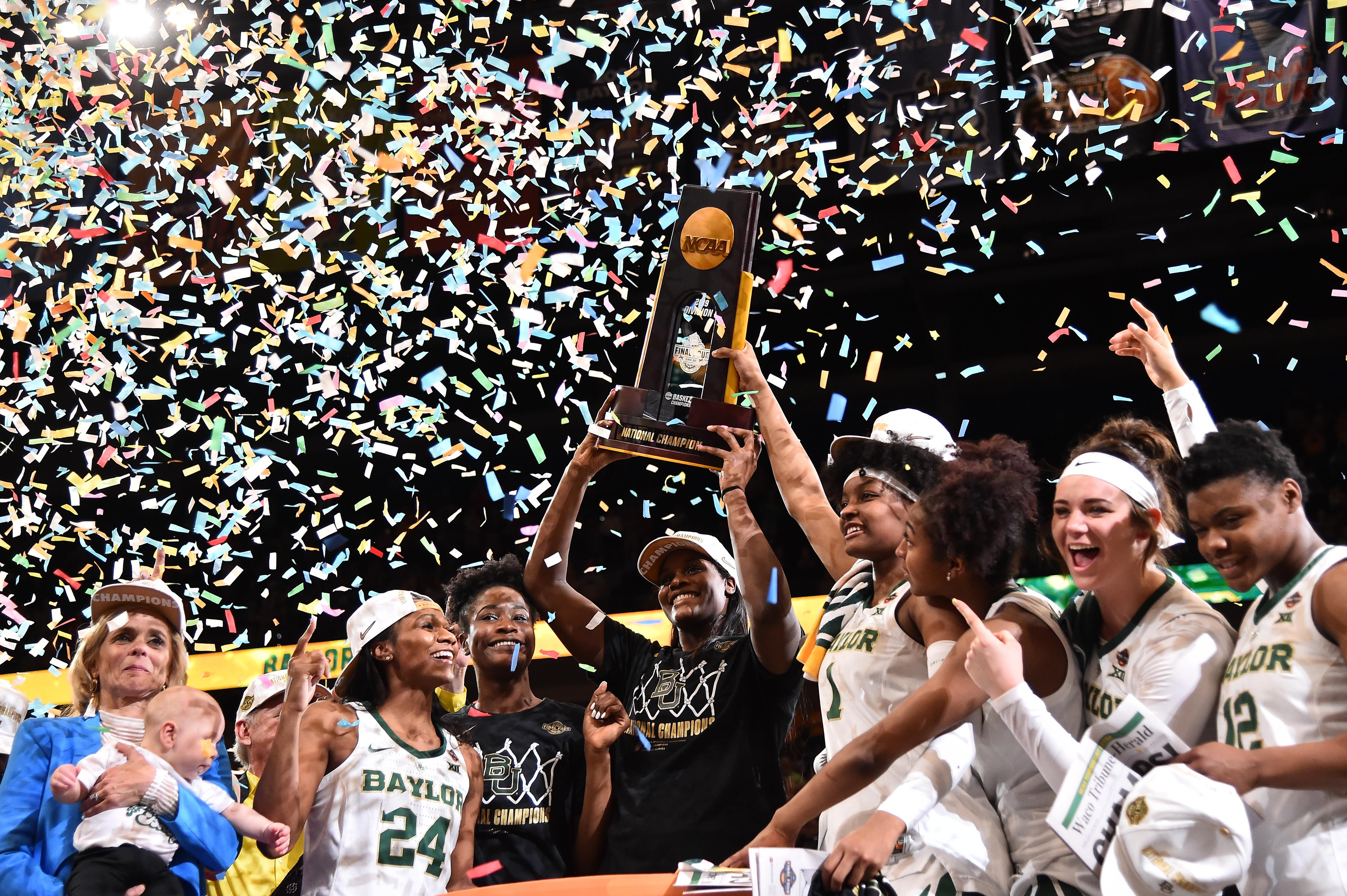 Apr 7, 2019; Tampa, FL, USA; Baylor Lady Bears center Kalani Brown (21) and teammates hoist the trophy after defeating the Notre Dame Fighting Irish to win the championship game of the women's Final Four of the 2019 NCAA Tournament at Amalie Arena. Mandatory Credit: Jasen Vinlove-USA TODAY Sports