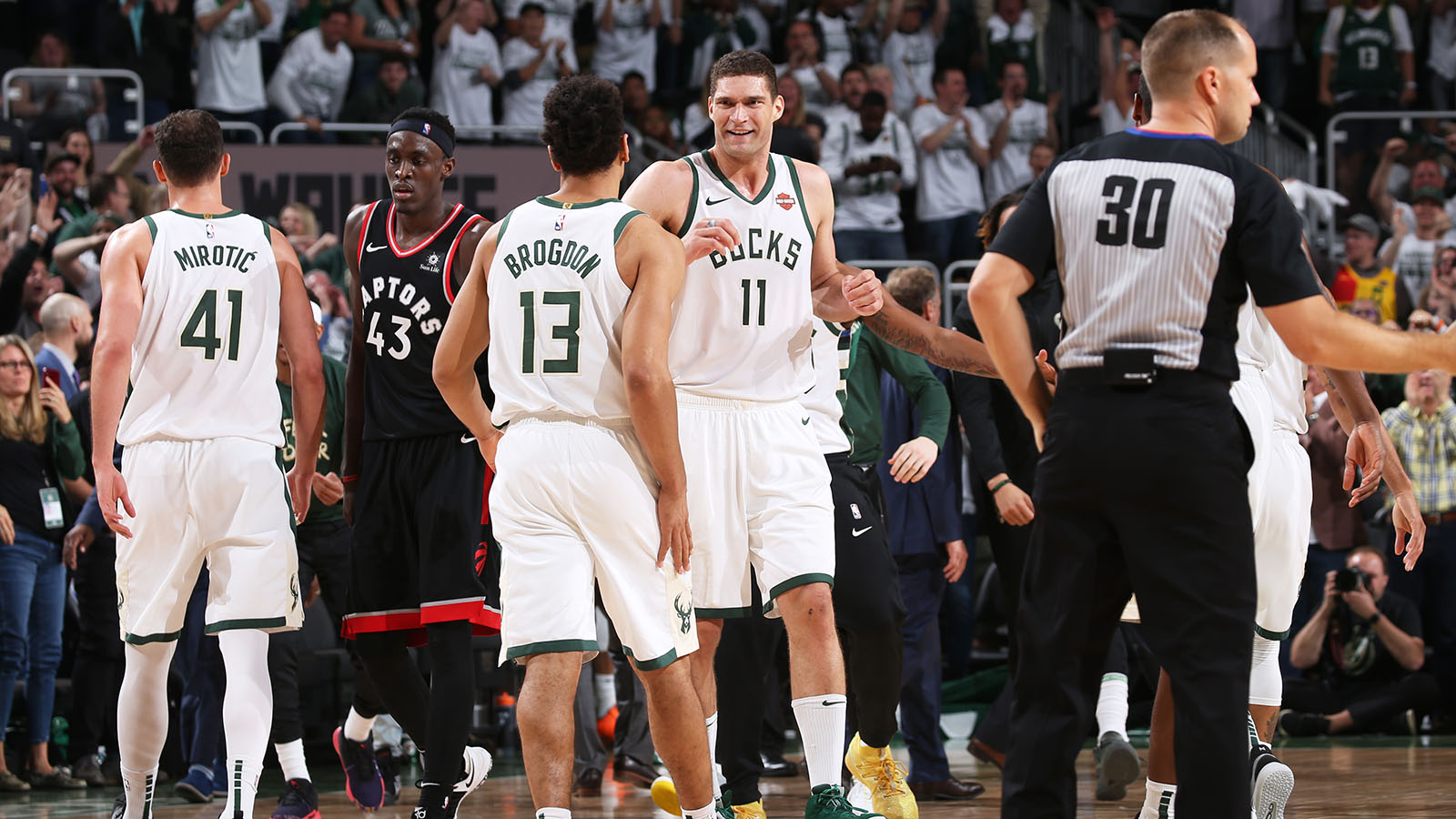 MILWAUKEE, WI - MAY 15: Brook Lopez #11 of the Milwaukee Bucks smiles during a game against the Toronto Raptors during Game One of the Eastern Conference Finals of the 2019 NBA Playoffs on May 15, 2019 at the Fiserv Forum Center in Milwaukee, Wisconsin. NOTE TO USER: User expressly acknowledges and agrees that, by downloading and or using this Photograph, user is consenting to the terms and conditions of the Getty Images License Agreement. Mandatory Copyright Notice: Copyright 2019 NBAE (Photo by Gary Dineen/NBAE via Getty Images).