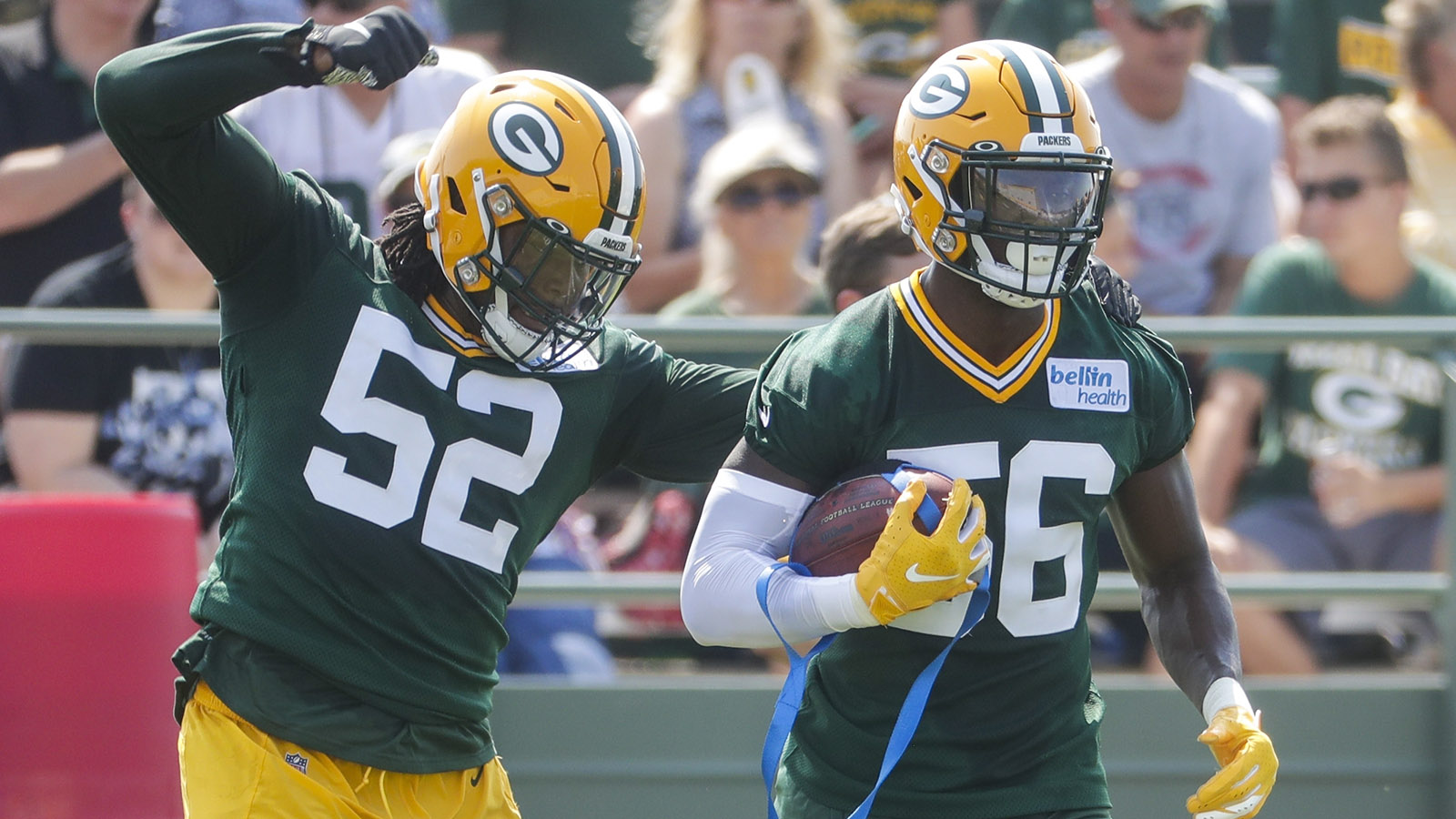 Green Bay Packers' Rashan Gary knocks the ball from Randy Ramsey during NFL football training camp Thursday, July 25, 2019, in Green Bay, Wis. (AP Photo/Morry Gash)