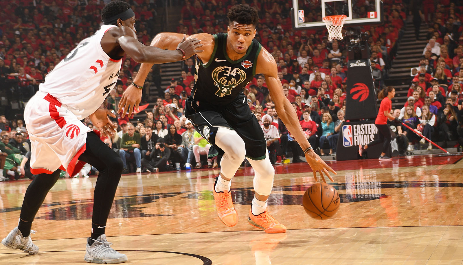 TORONTO, CANADA - MAY 25: Giannis Antetokounmpo #34 of the Milwaukee Bucks handles the ball during the game against Pascal Siakam #43 of the Toronto Raptors during Game Six of the Eastern Conference Finals on May 25, 2019 at Scotiabank Arena in Toronto, Ontario, Canada. NOTE TO USER: User expressly acknowledges and agrees that, by downloading and/or using this photograph, user is consenting to the terms and conditions of the Getty Images License Agreement. Mandatory Copyright Notice: Copyright 2019 NBAE (Photo by Ron Turenne/NBAE via Getty Images)