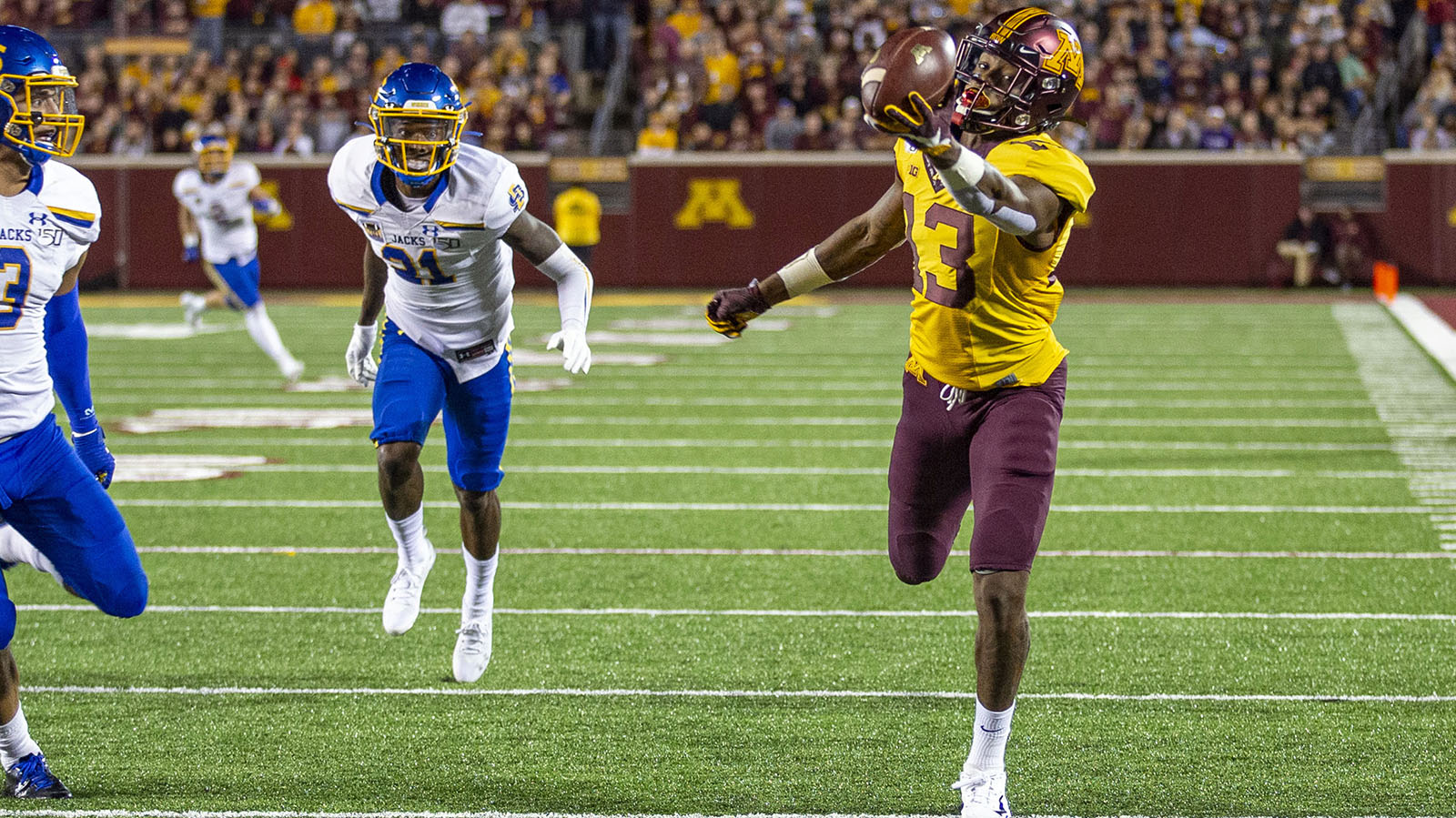 Aug 29, 2019; Minneapolis, MN, USA; Minnesota Golden Gophers wide receiver Rashod Bateman (13) catches a pass for a touchdown in the first half against the South Dakota State Jackrabbits at TCF Bank Stadium. Mandatory Credit: Jesse Johnson-USA TODAY Sports