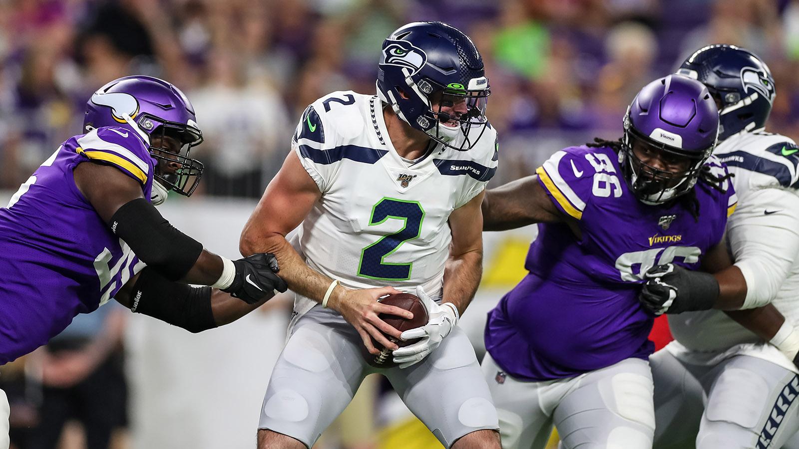 Aug 18, 2019; Minneapolis, MN, USA; Minnesota Vikings defensive lineman Ifeadi Odenigbo (95) and Armon Watts (96) sack Seattle Seahawks quarterback Paxton Lynch (2) during the second quarter at U.S. Bank Stadium. Mandatory Credit: Brace Hemmelgarn-USA TODAY Sports