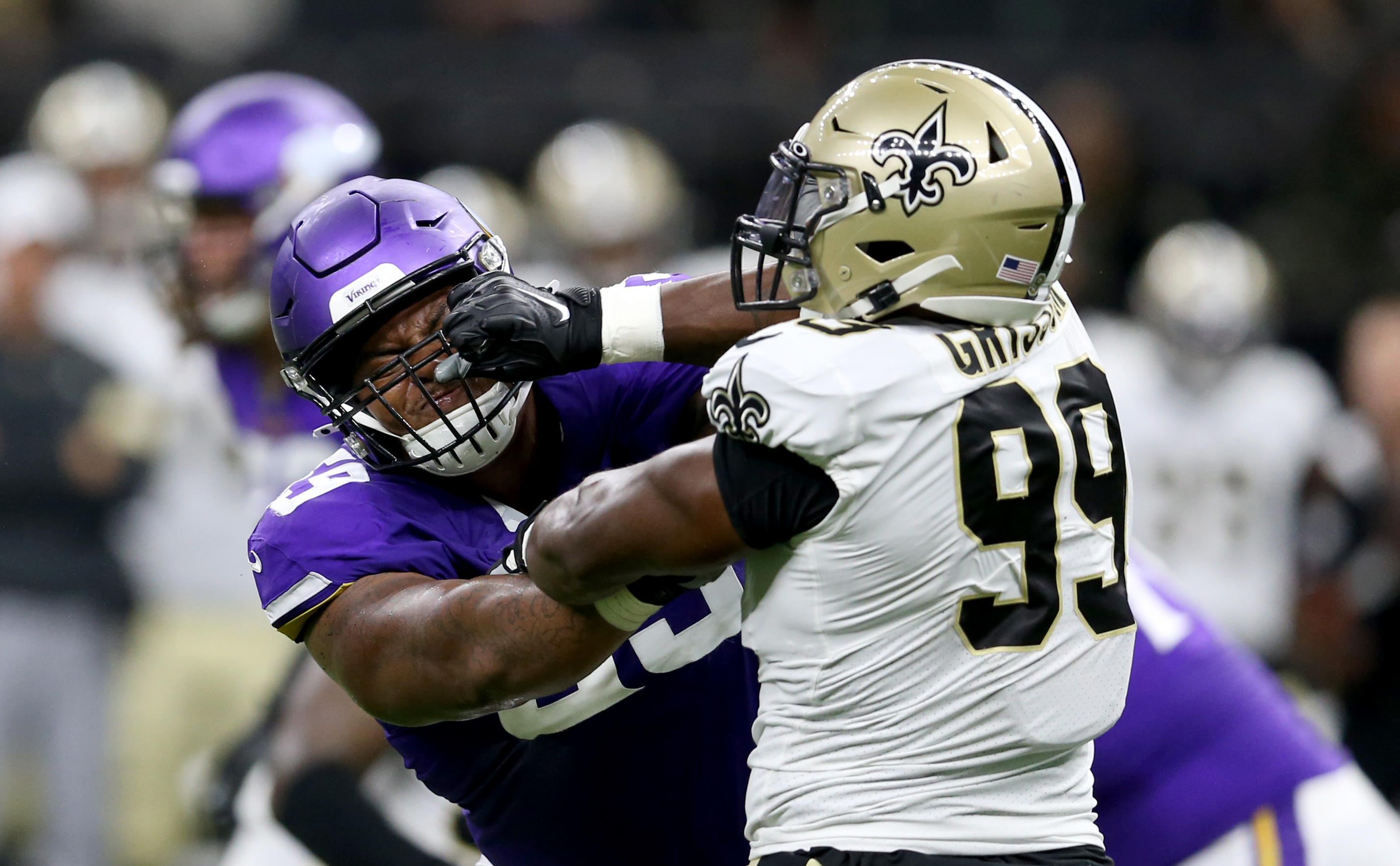 Aug 9, 2019; New Orleans, LA, USA; Minnesota Vikings offensive tackle Rashod Hill (69) blocks against New Orleans Saints defensive end Geneo Grissom (99) in the second quarter at the Mercedes-Benz Superdome. Mandatory Credit: Chuck Cook-USA TODAY Sports