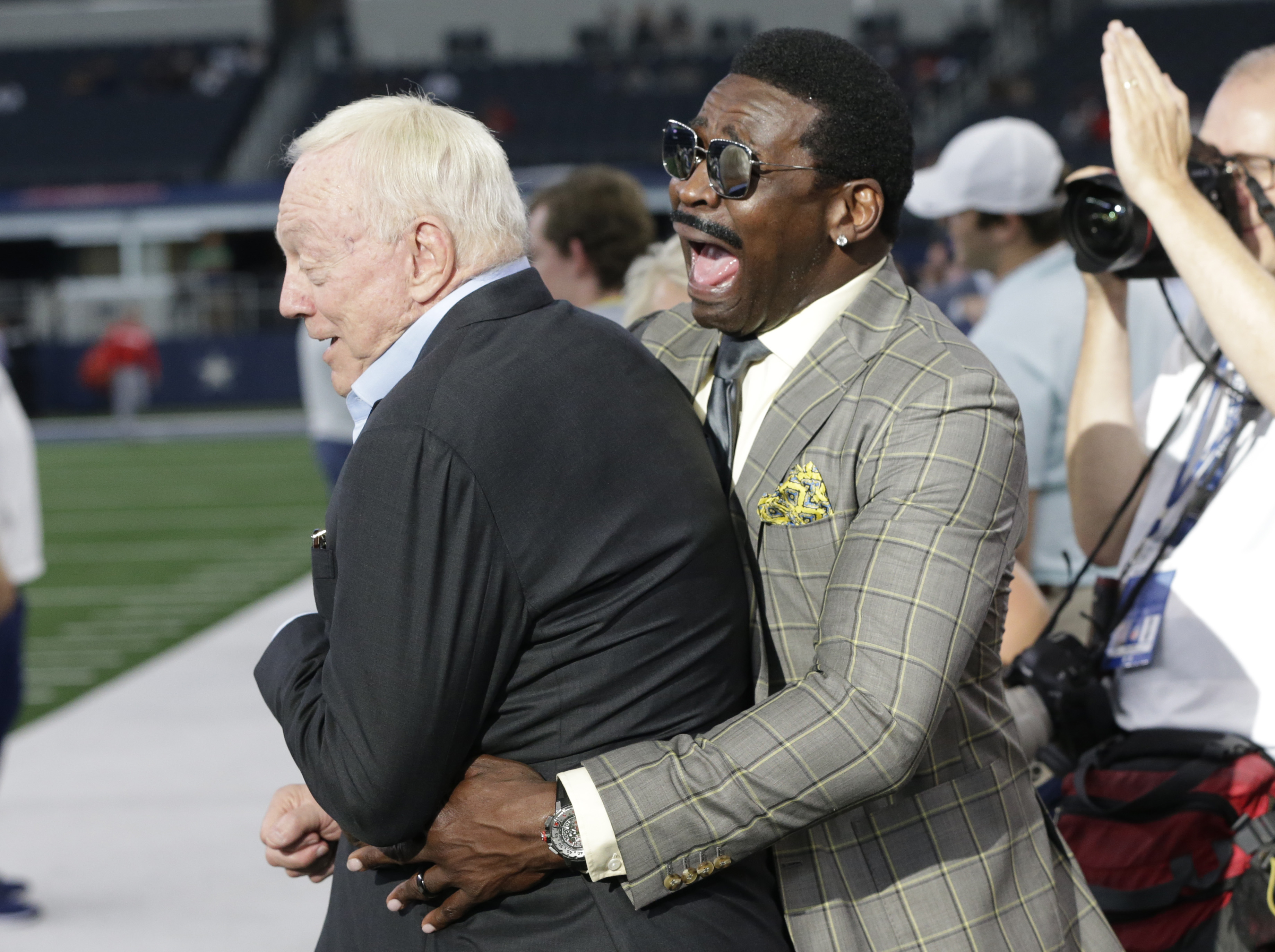 Aug 29, 2019; Arlington, TX, USA; Former Dallas Cowboys Michael Irvin interacts with owner Jerry Jones before the game against the Tampa Bay Buccaneers at AT&T Stadium. Mandatory Credit: Tim Heitman-USA TODAY Sports