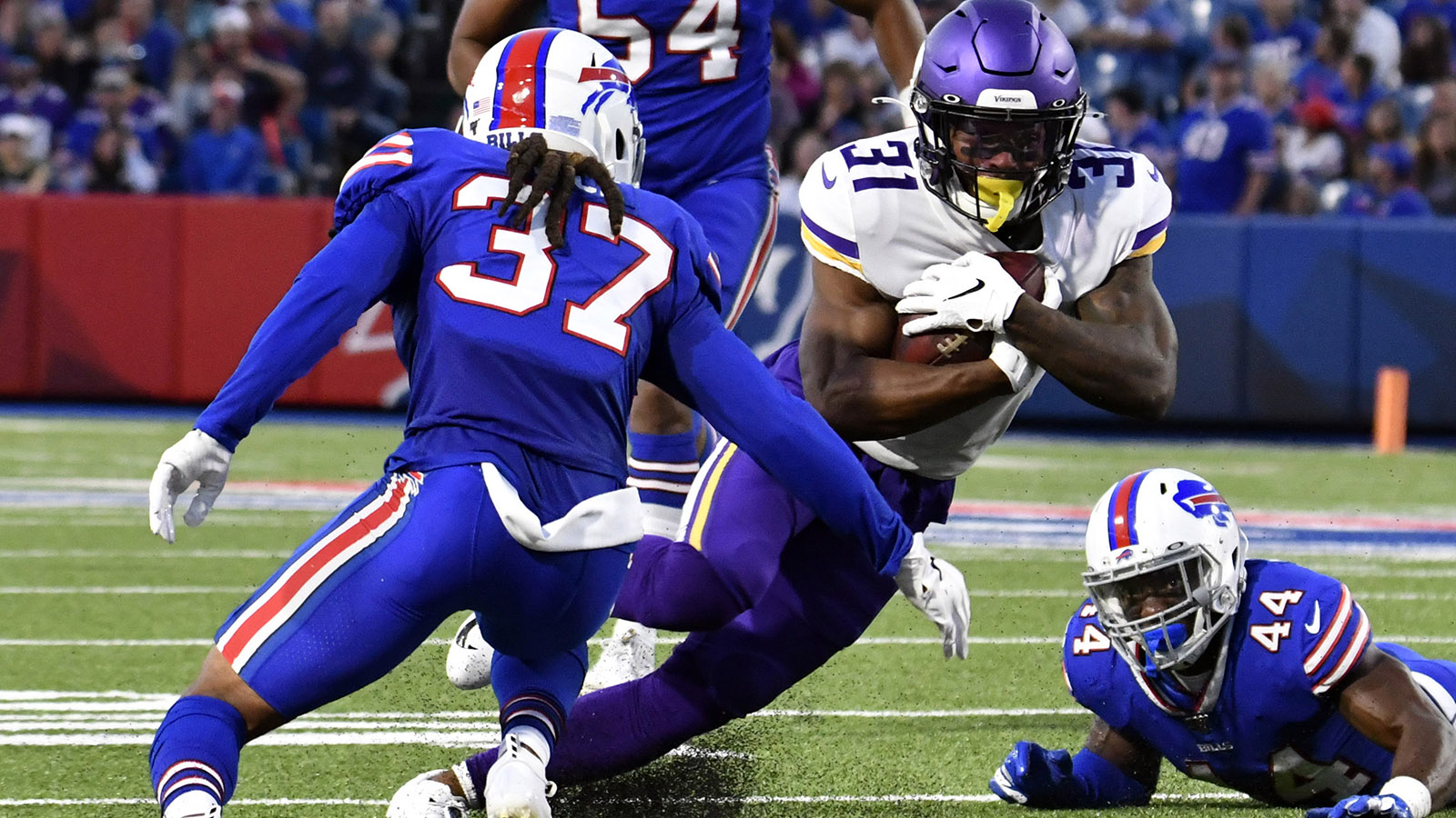 Aug 29, 2019; Orchard Park, NY, USA; Minnesota Vikings running back Ameer Abdullah (31) tries to run between Buffalo Bills defensive back Denzel Rice (37) and linebacker Deon Lacey (44)  in the second quarter at New Era Field. Mandatory Credit: Mark Konezny-USA TODAY Sports
