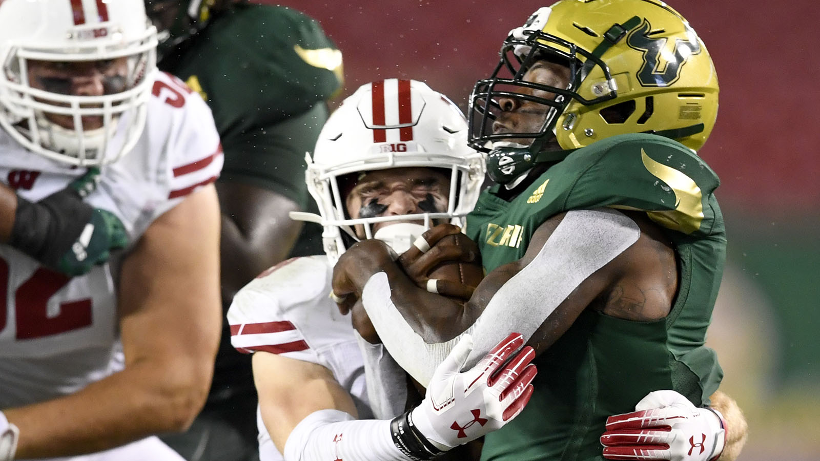 Aug 30, 2019; Tampa, FL, USA; South Florida Bulls running back Jordan Cronkrite (2) runs the ball as Wisconsin Badgers safety Scott Nelson (9) defends during the second half at Raymond James Stadium. Mandatory Credit: Douglas DeFelice-USA TODAY Sports