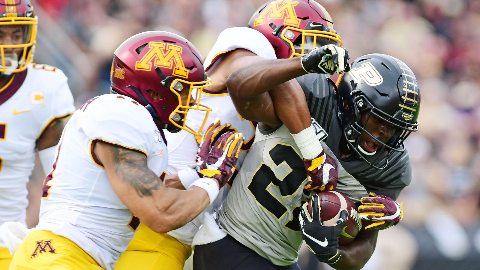 Sep 28, 2019; West Lafayette, IN, USA; Purdue Boilermakers running back King Doerue (22) goes up the middle against the Minnesota Gophers defense during the first half  at Ross-Ade Stadium. Mandatory Credit: Thomas J. Russo-USA TODAY Sports