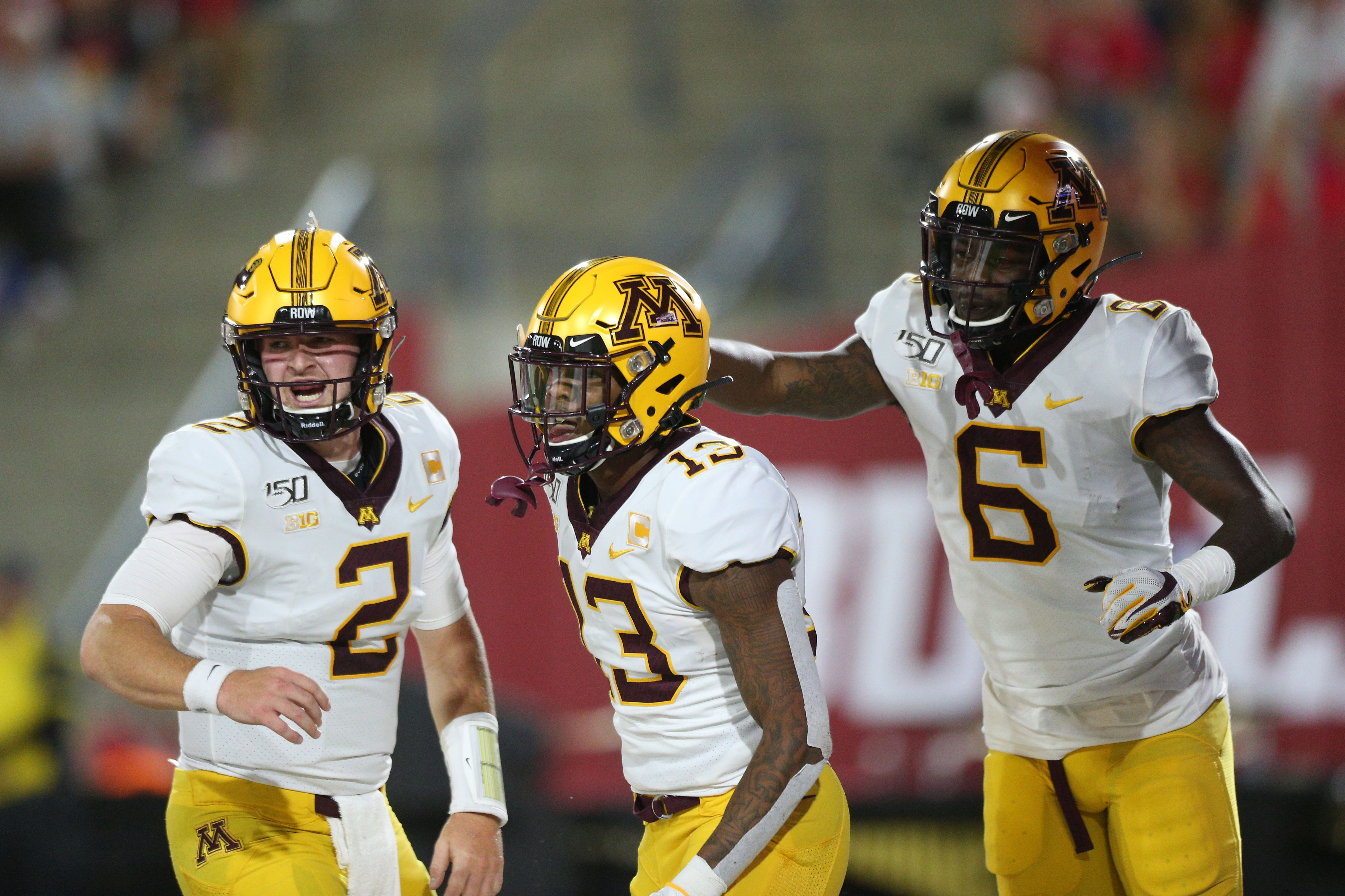 Sep 7, 2019; Fresno, CA, USA; Minnesota Golden Gophers wide receiver Rashod Bateman (13) is congratulated by wide receiver Tyler Johnson (6) and quarterback Tanner Morgan (2) after catching a touchdown against the Fresno State Bulldogs in the first quarter at Bulldog Stadium. Mandatory Credit: Cary Edmondson-USA TODAY Sports