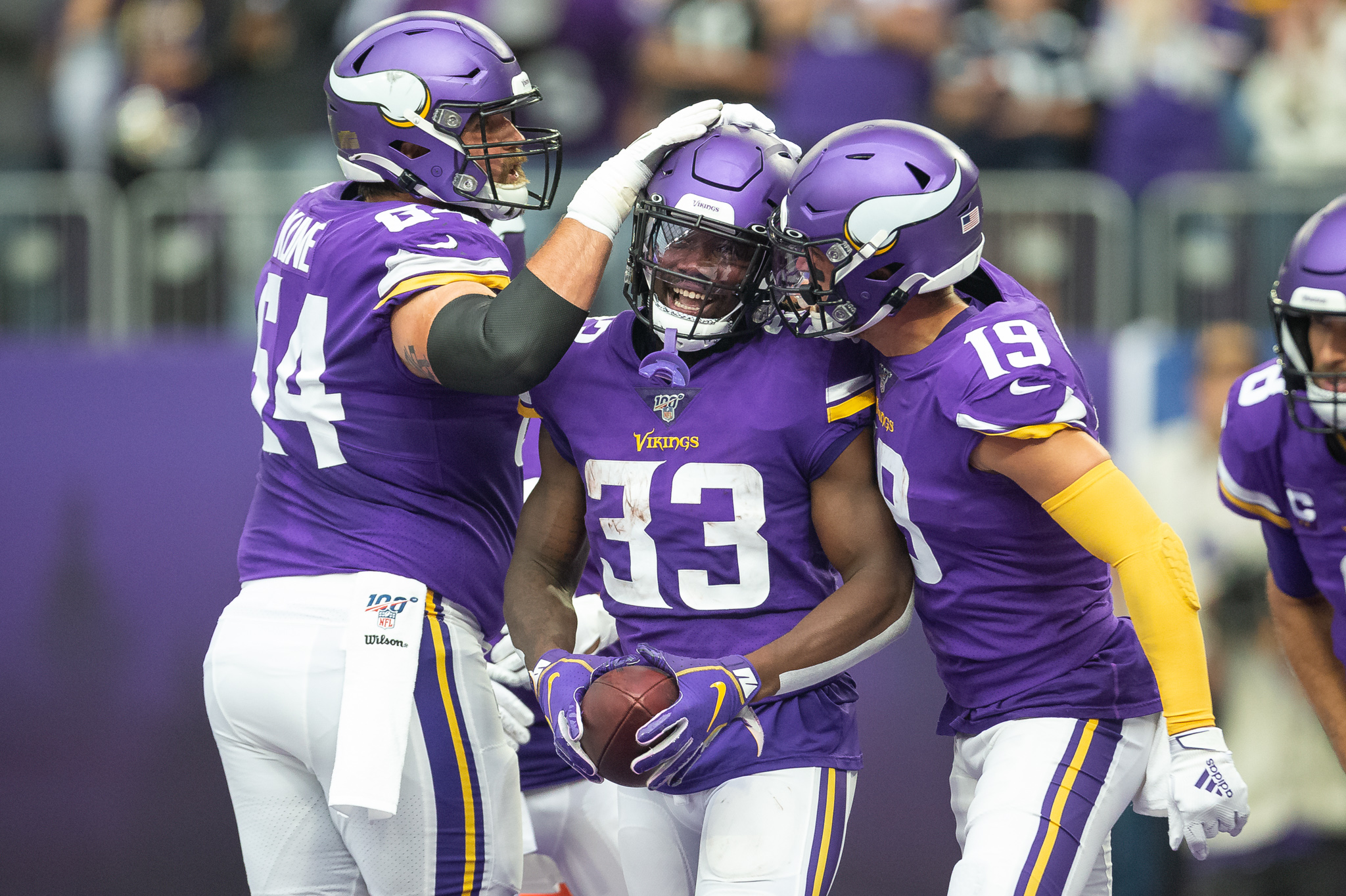 Sep 8, 2019; Minneapolis, MN, USA; Minnesota Vikings running back Dalvin Cook (33) celebrates with offensive guard Josh Kline (64) and wide receiver Adam Thielen (19) after scoring a touchdown against the Atlanta Falcons during the first quarter at U.S. Bank Stadium. Mandatory Credit: Harrison Barden-USA TODAY Sports