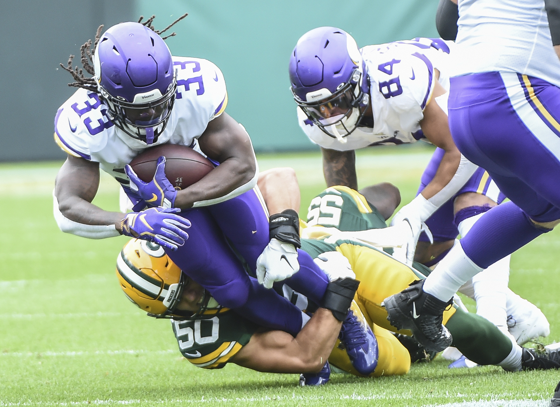Sep 15, 2019; Green Bay, WI, USA;  Minnesota Vikings running back Dalvin Cook (33) is tackled by Green Bay Packers linebacker Blake Martinez (50) in the first quarter at Lambeau Field. Mandatory Credit: Benny Sieu-USA TODAY Sports