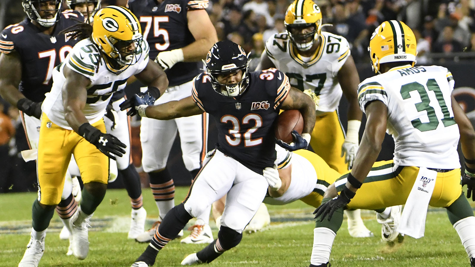 Chicago Bears' David Montgomery runs during the first half of an NFL football game against the Green Bay Packers Thursday, Sept. 5, 2019, in Chicago. (AP Photo/David Banks)