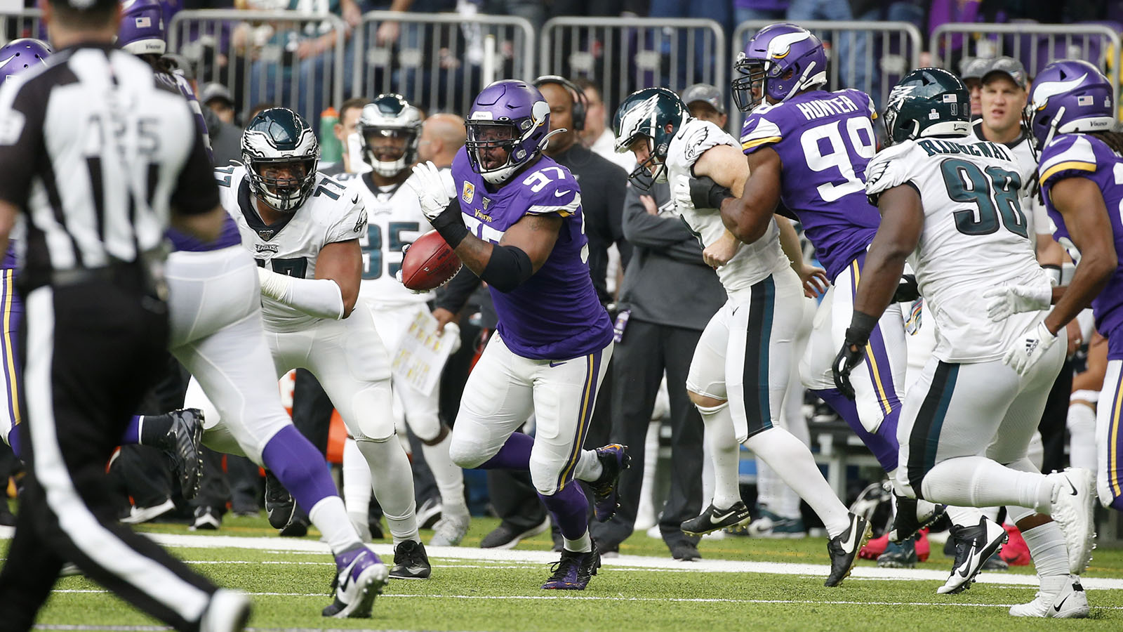 Minnesota Vikings defensive end Everson Griffen (97) returns an interception on a Philadelphia Eagles fake field goal attempt during the first half of an NFL football game, Sunday, Oct. 13, 2019, in Minneapolis. (AP Photo/Bruce Kluckhohn)