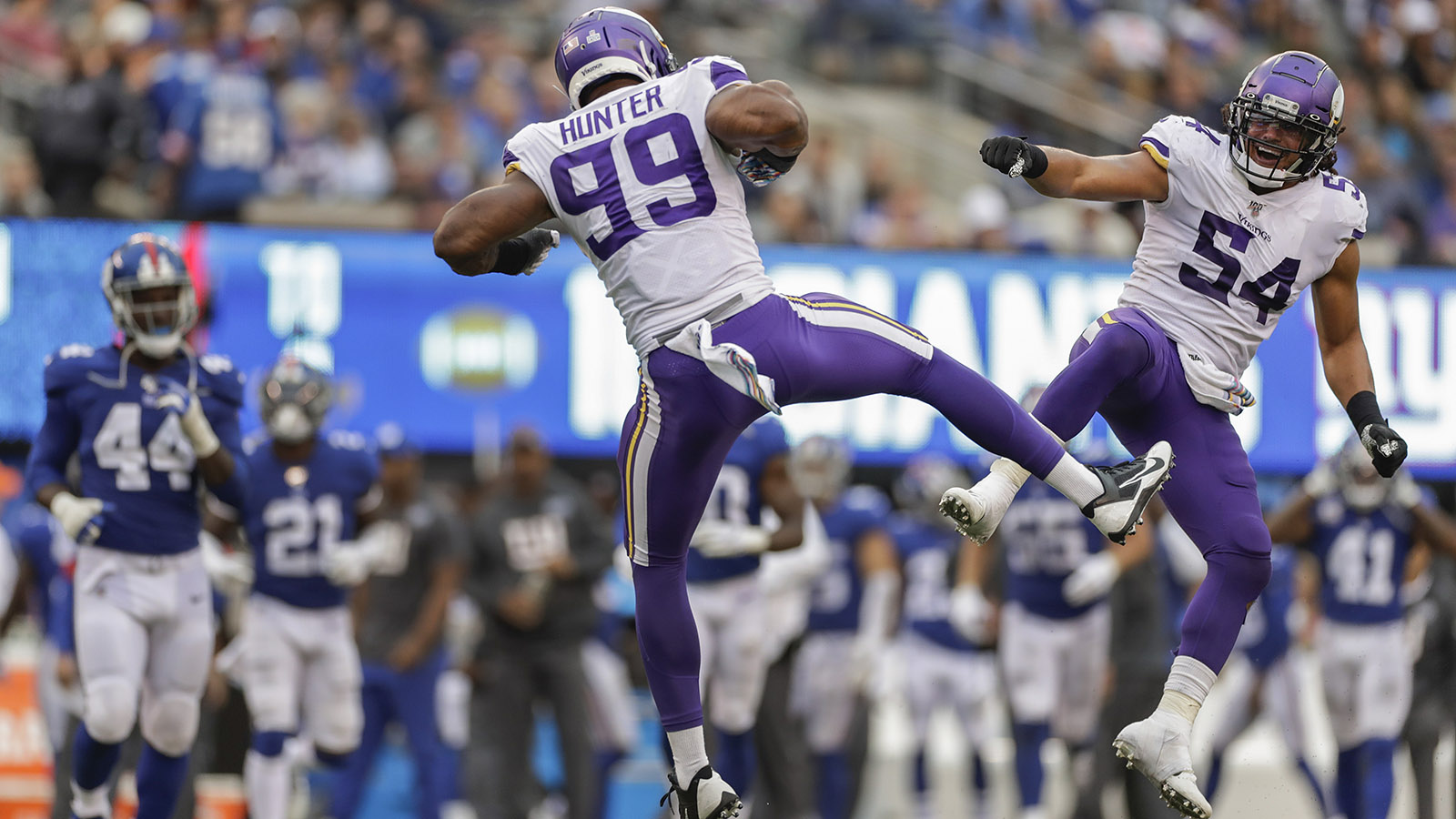 Minnesota Vikings middle linebacker Eric Kendricks (54) and defensive end Danielle Hunter (99) celebrate after a defensive play against the New York Giants during the third quarter of an NFL football game, Sunday, Oct. 6, 2019, in East Rutherford, N.J. (AP Photo/Adam Hunger)